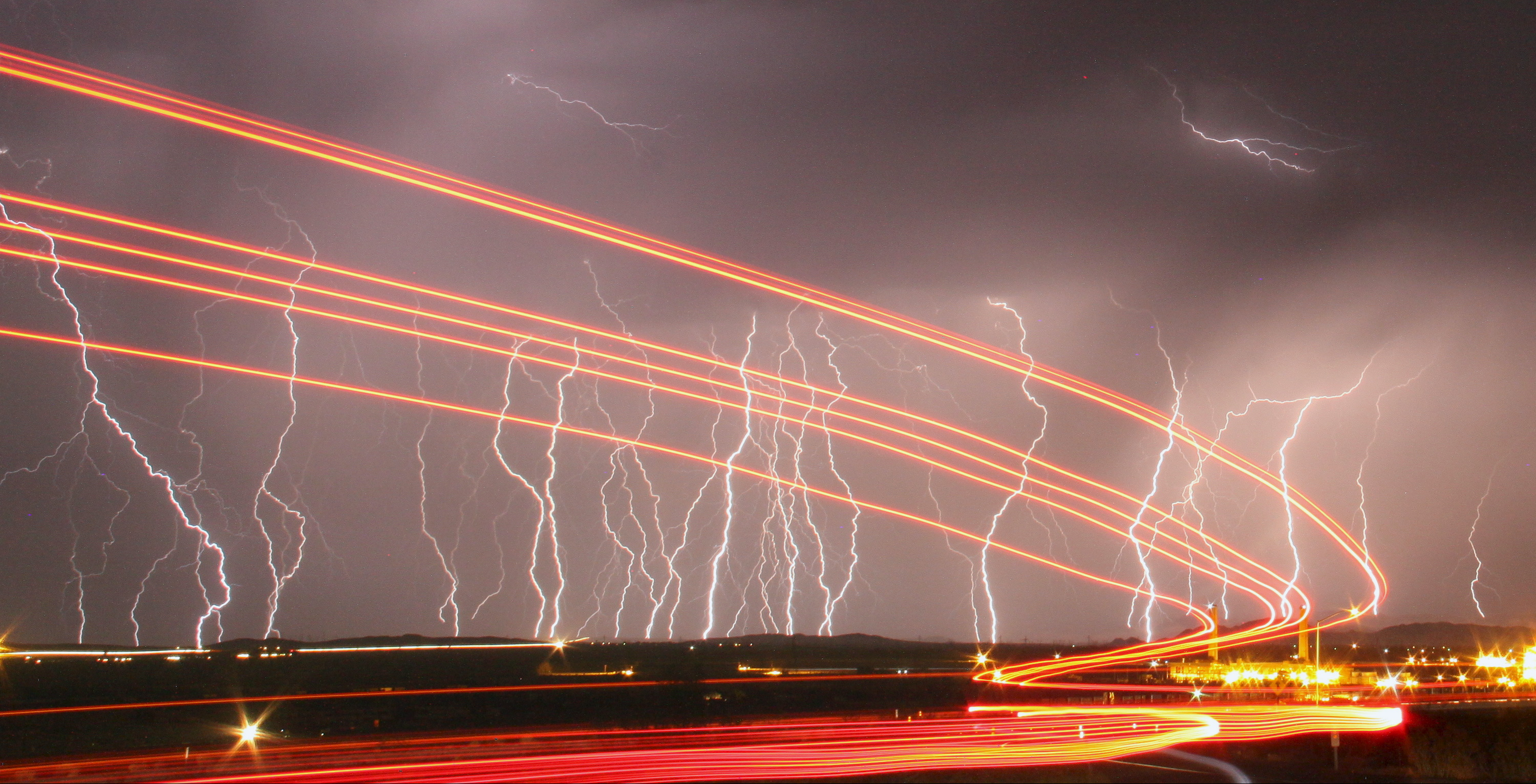 Mass lightning bolts light up night skies by the Daggett airport from monsoon storms passing over the high deserts early Wednesday, north of Barstow, California July 1, 2015. Picture taken using long exposure.  - GF10000145573