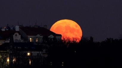 The supermoon rises in Prague