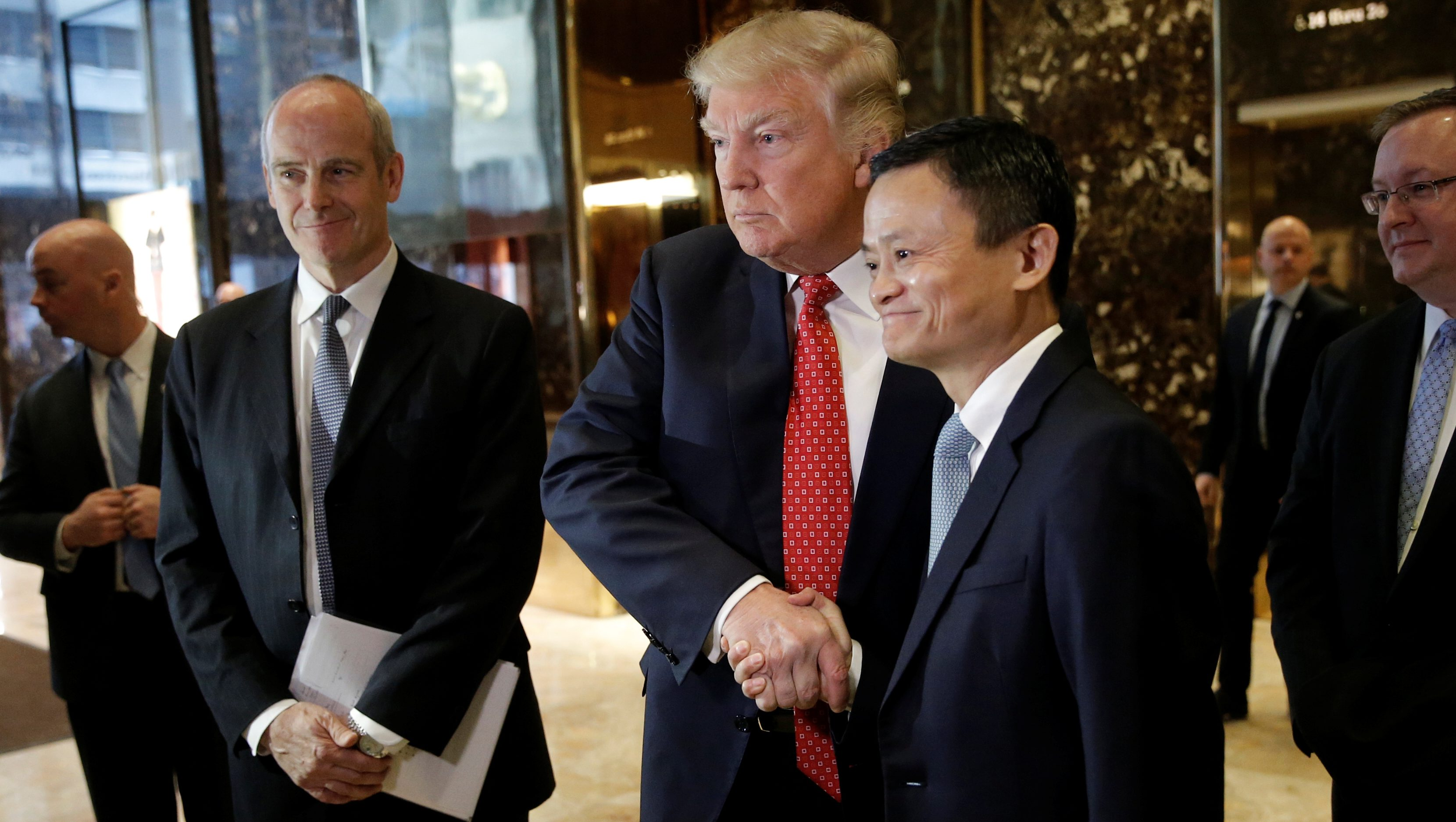 U.S. President-elect Donald Trump shakes hands with and Alibaba executive chairman Jack Ma after their meeting at Trump Tower in New York, U.S., January 9, 2017.