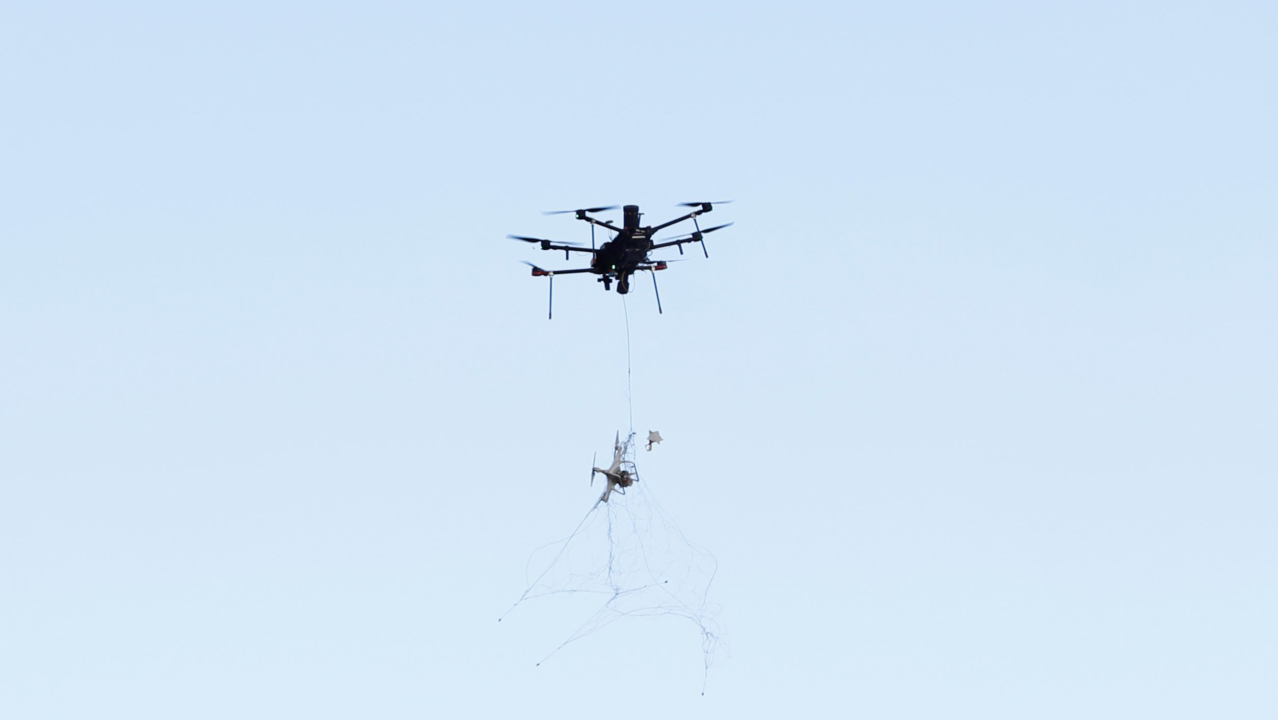 An Airspace Systems Interceptor autonomous aerial drone releases a kevlar net to capture a simulated hostile drone during a product demonstration in Castro Valley, California March 6, 2017.  Picture taken March 6, 2017.