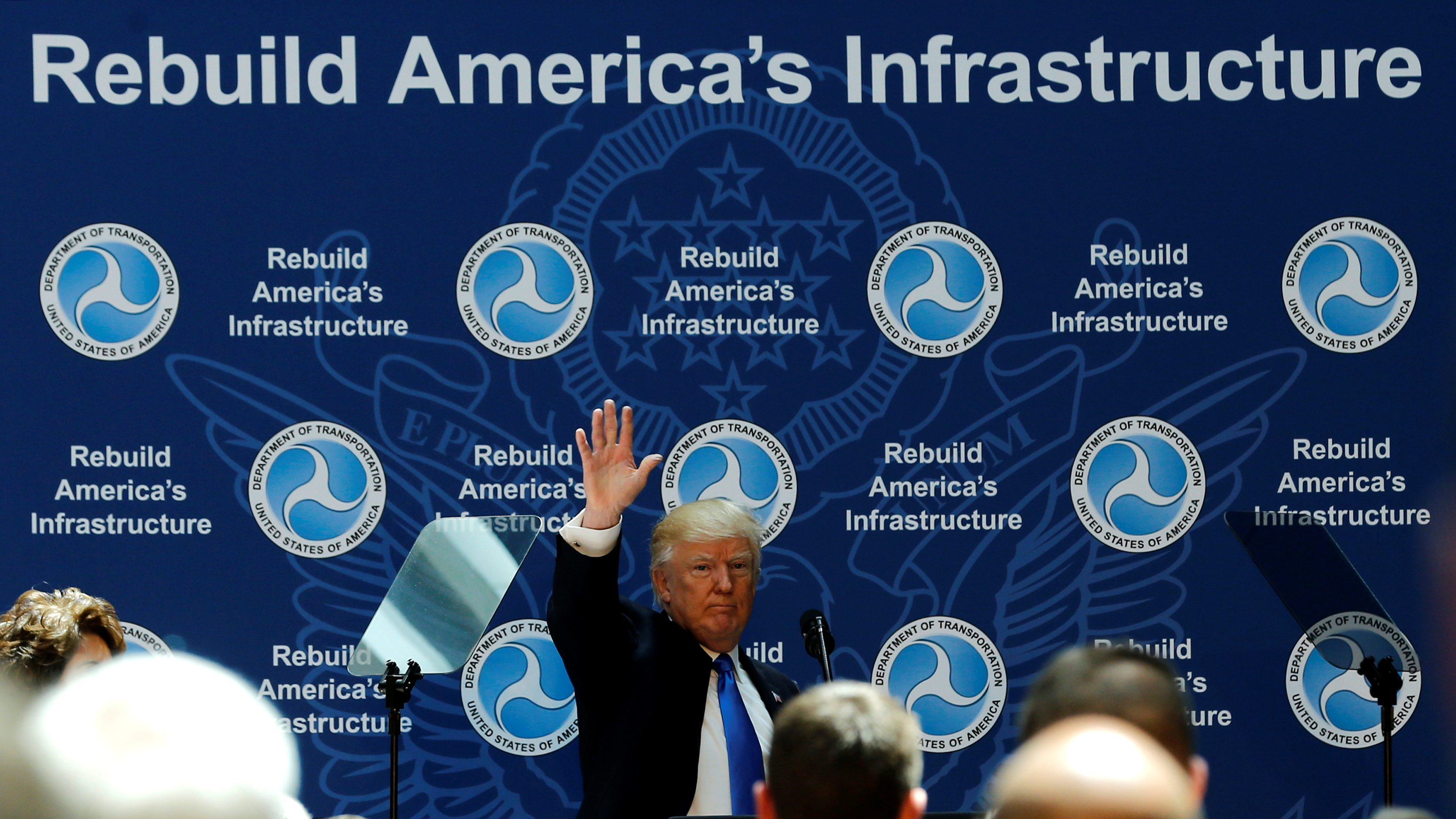 U.S. President Donald Trump concludes his remarks on infrastructure improvements, at the Department of Transportation in Washington, U.S.