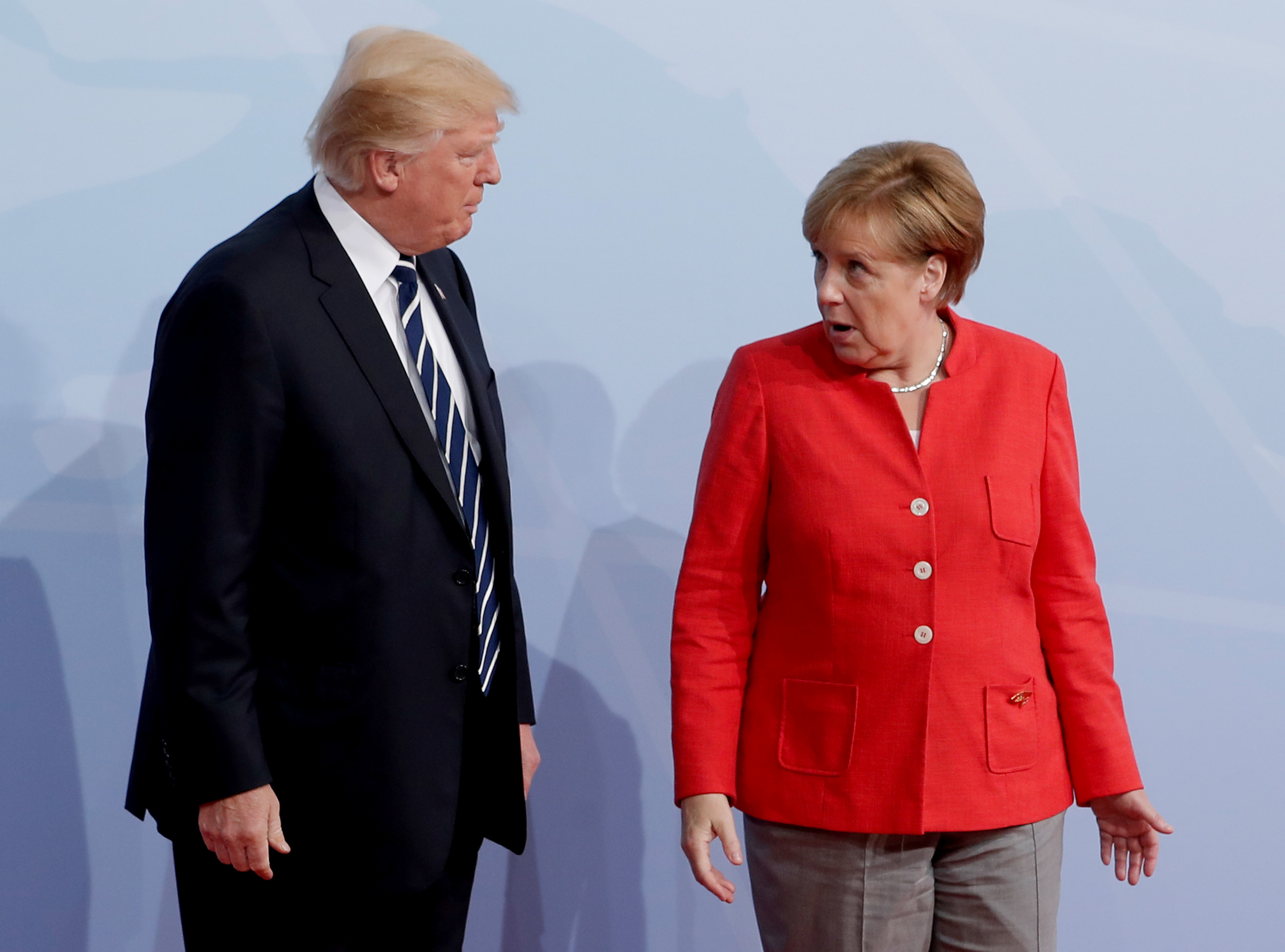 German Chancellor Angela Merkel welcomes U.S. President Donald Trump to the opening day of the G20 leaders summit in Hamburg, Germany, July 7, 2017.  REUTERS/Ian Langsdon/Pool - RC16DEBCE8C0