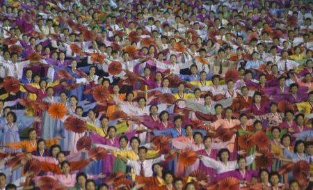 People take part in a performance during the celebrations for the National Liberation Day in the city of Pyongyang, North Korea August 15, 2005. Picture taken August 15, 2005.