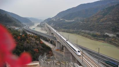 A bullet train of the new high-speed rail line linking Xi'an and Chengdu runs on a bridge in Guangyuan, Sichuan province, China December 6, 2017.