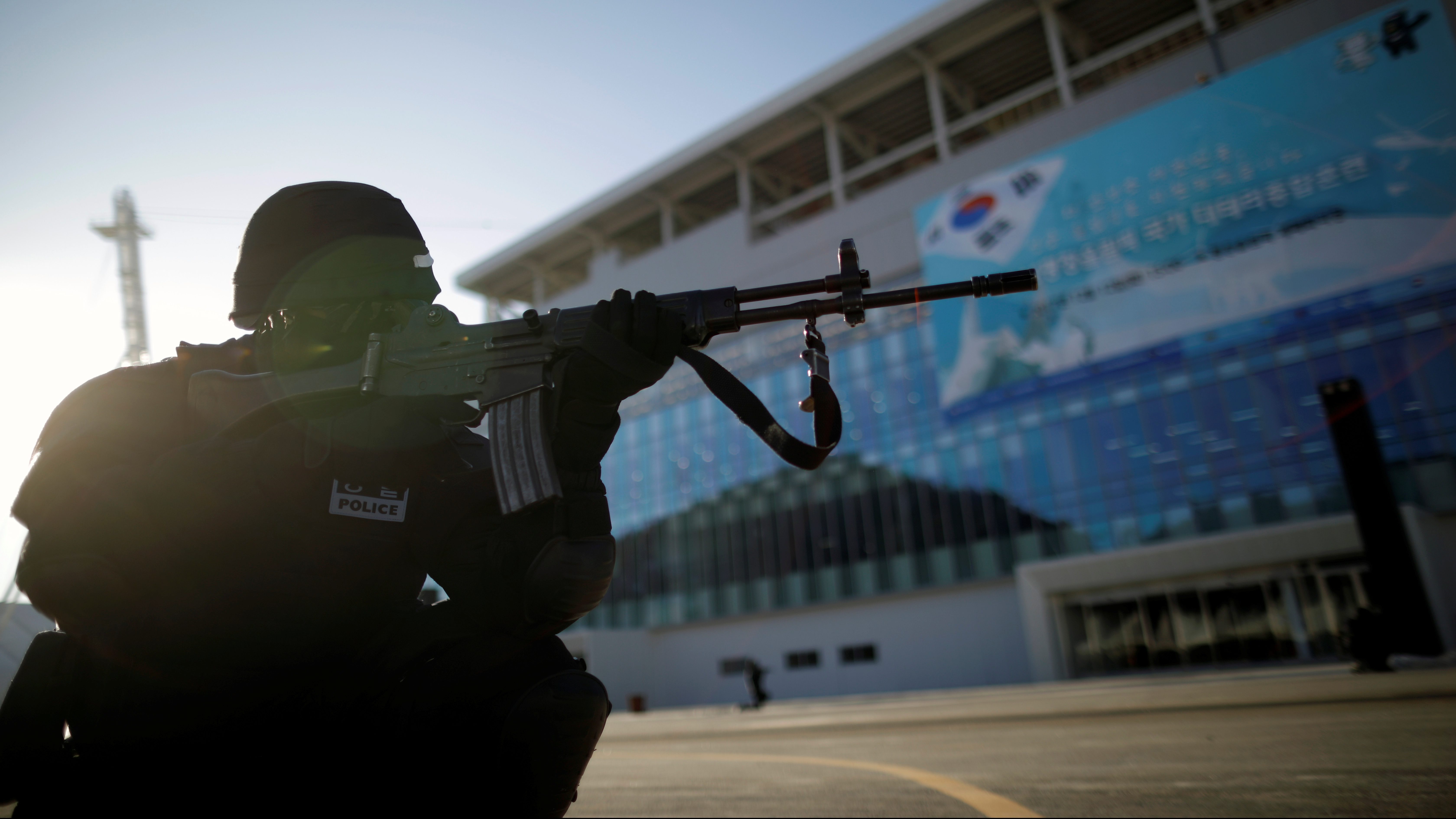 A South Korean police officer takes part in a security drill ahead of the 2018 Pyeongchang Winter Olympic Games at the Olympic Stadium, the venue for the opening and closing ceremony in Pyeongchang, South Korea December 12, 2017.