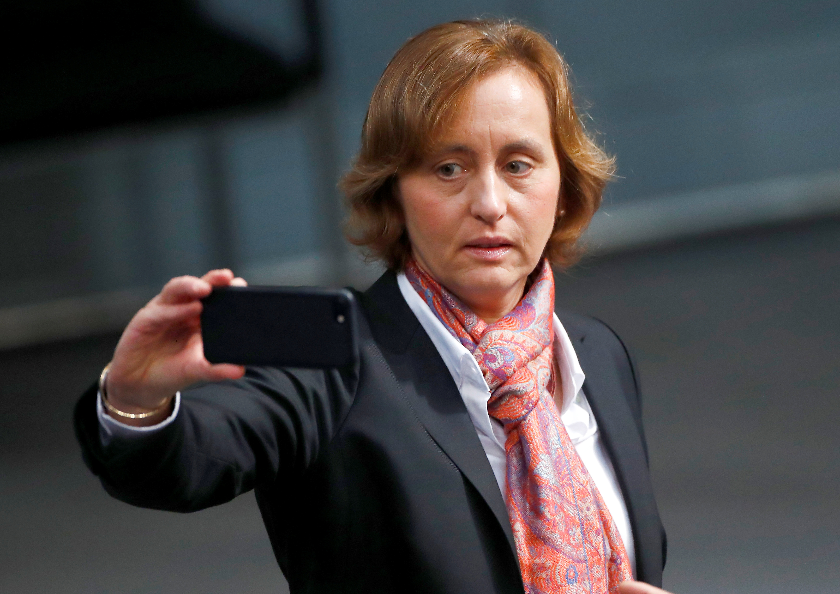 """FILE PHOTO: Co-leader of the anti-immigration party Alternative for Germany (AfD) Beatrix von Storch arrives at the German lower house of Parliament, Bundestag,  in Berlin, Germany, October 24, 2017. German police have asked prosecutors to investigate a far-right lawmaker for possible incitement to hatred after she criticised a police force for tweeting in Arabic """"to appease the barbaric, Muslim, rapist hoards of men"""".REUTERS/Hannibal Hanschke/File Photo - RC1F131D3CE0"""