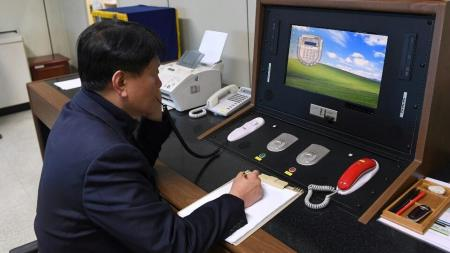 Korean government official checks the direct communications hotline to talk with the North Korean side at the border village of Panmunjom