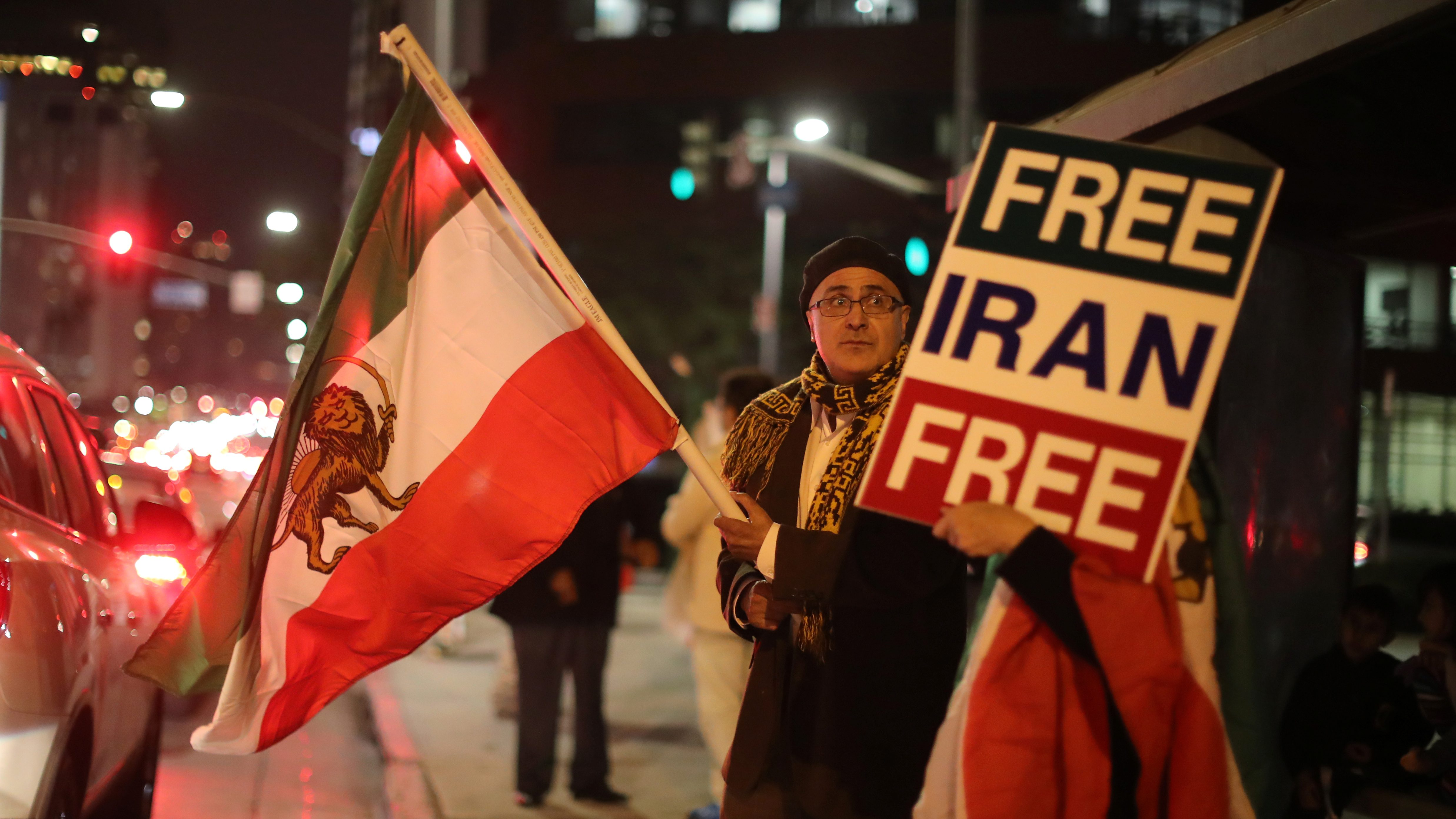 People protest in Los Angeles, California, U.S., in support of anti-government protesters in Iran,  January 3, 2018.  - RC1D411FC240