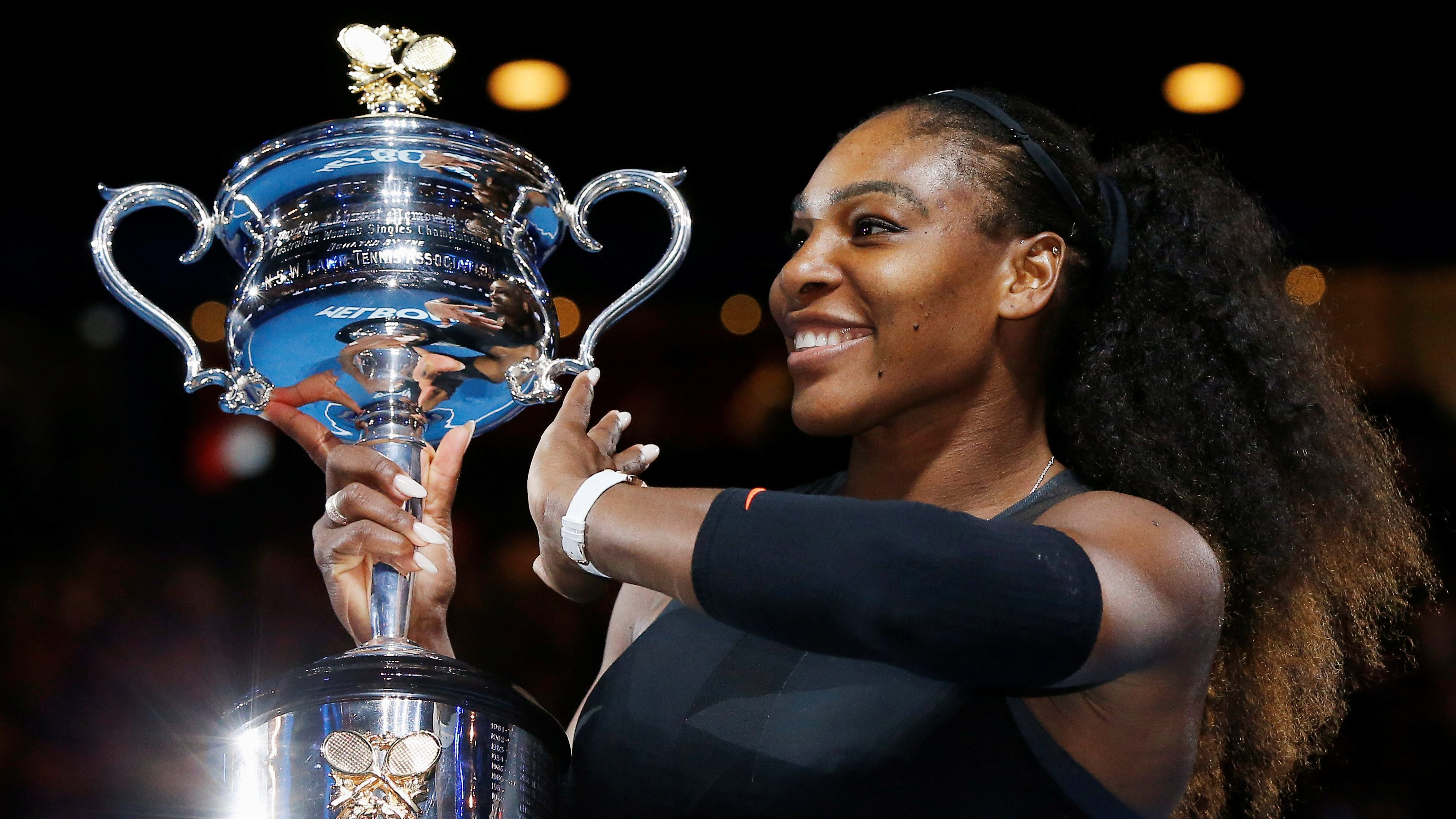 FILE PHOTO: Tennis - Australian Open - Melbourne Park, Melbourne, Australia - 28/1/17 Serena Williams of the U.S. holds her trophy after winning her Women's singles final match against Venus Williams of the U.S. .REUTERS/Issei Kato/File photo - RC1A1FDA3460