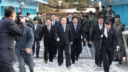 The North Korean delegation led by Ri Son Gwon, Chairman of the Committee for the Peaceful Reunification of the Country (CPRC) of DPRK, cross the concrete border to attend a meeting at the truce village of Panmunjom in the demilitarised zone separating the two Koreas, South Korea, January 9, 2018.