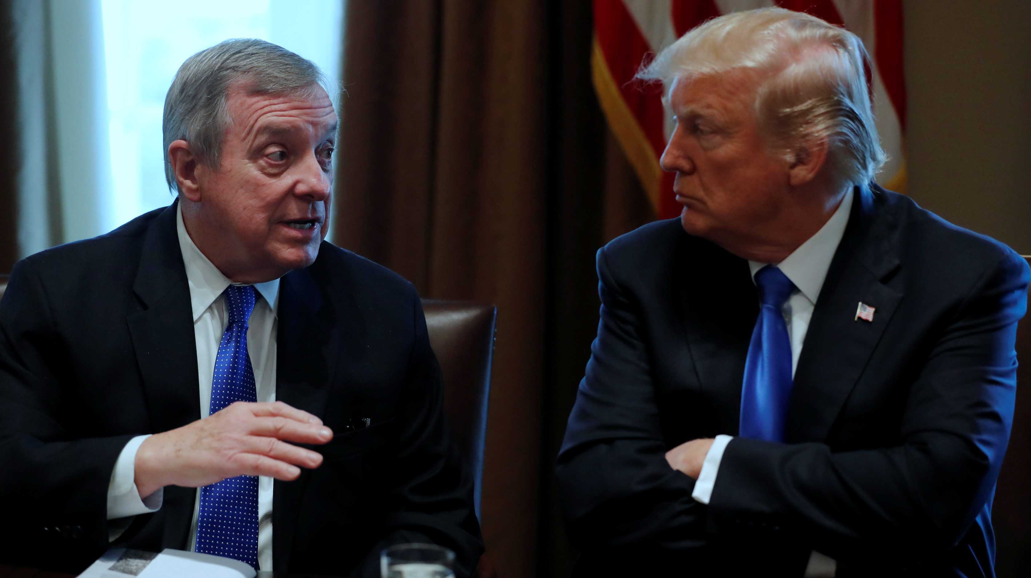 U.S. President Donald Trump, flanked by U.S. Senator Dick Durbin (D-IL), holds a bipartisan meeting with legislators on immigration reform at the White House in Washington, U.S. January 9, 2018.  REUTERS/Jonathan Ernst - RC137D306230