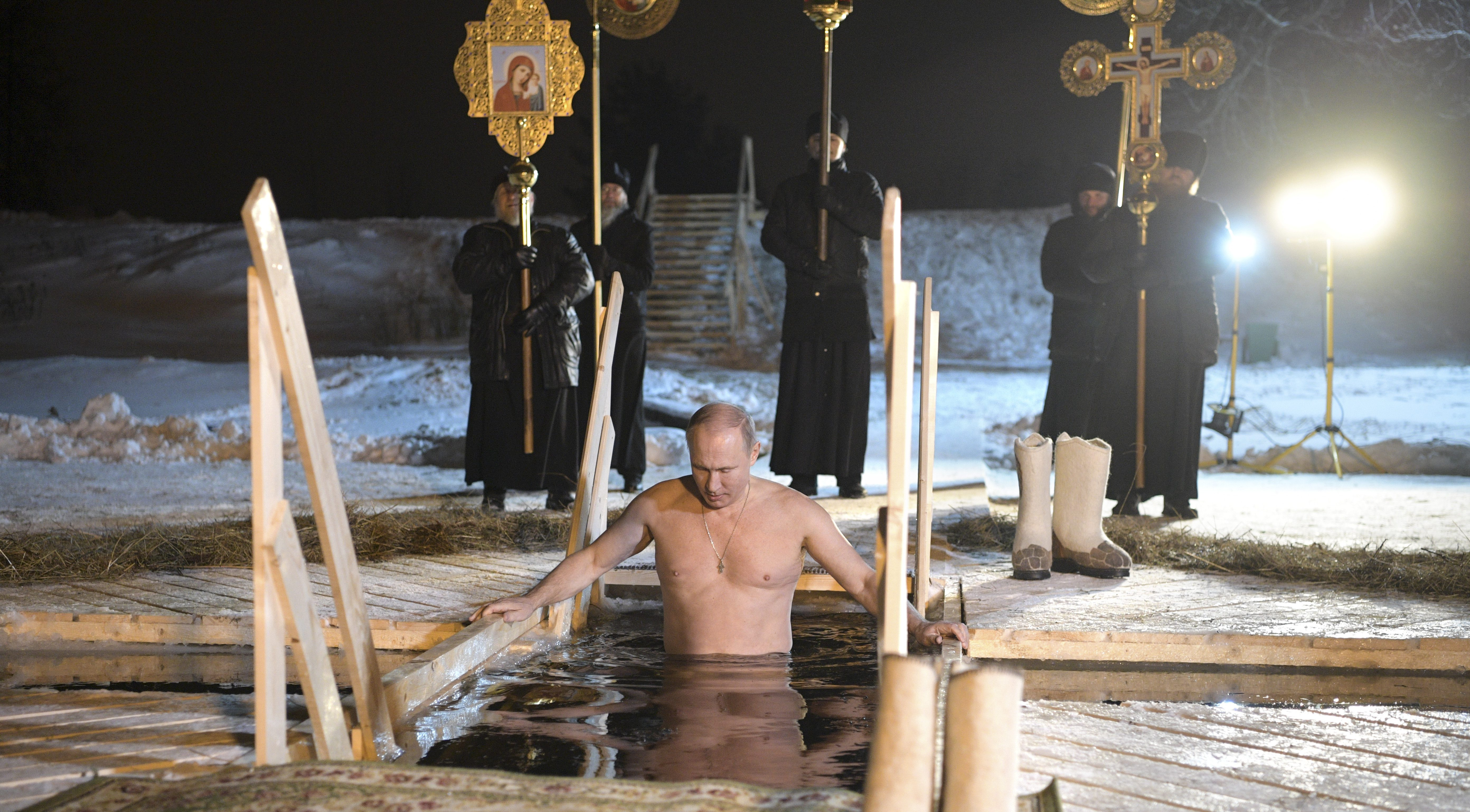 Russian President Putin takes a dip in the freezing waters of Lake Seliger during Orthodox Epiphany celebrations in Tver region