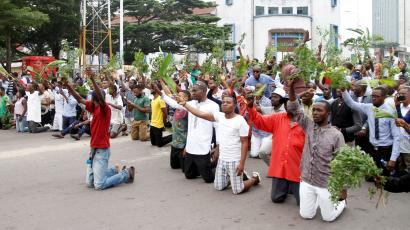 Demonstrators kneel and chant slogans during a protest organised by Catholic activists in Kinshasa, Democratic Republic of Congo January 21, 2018.