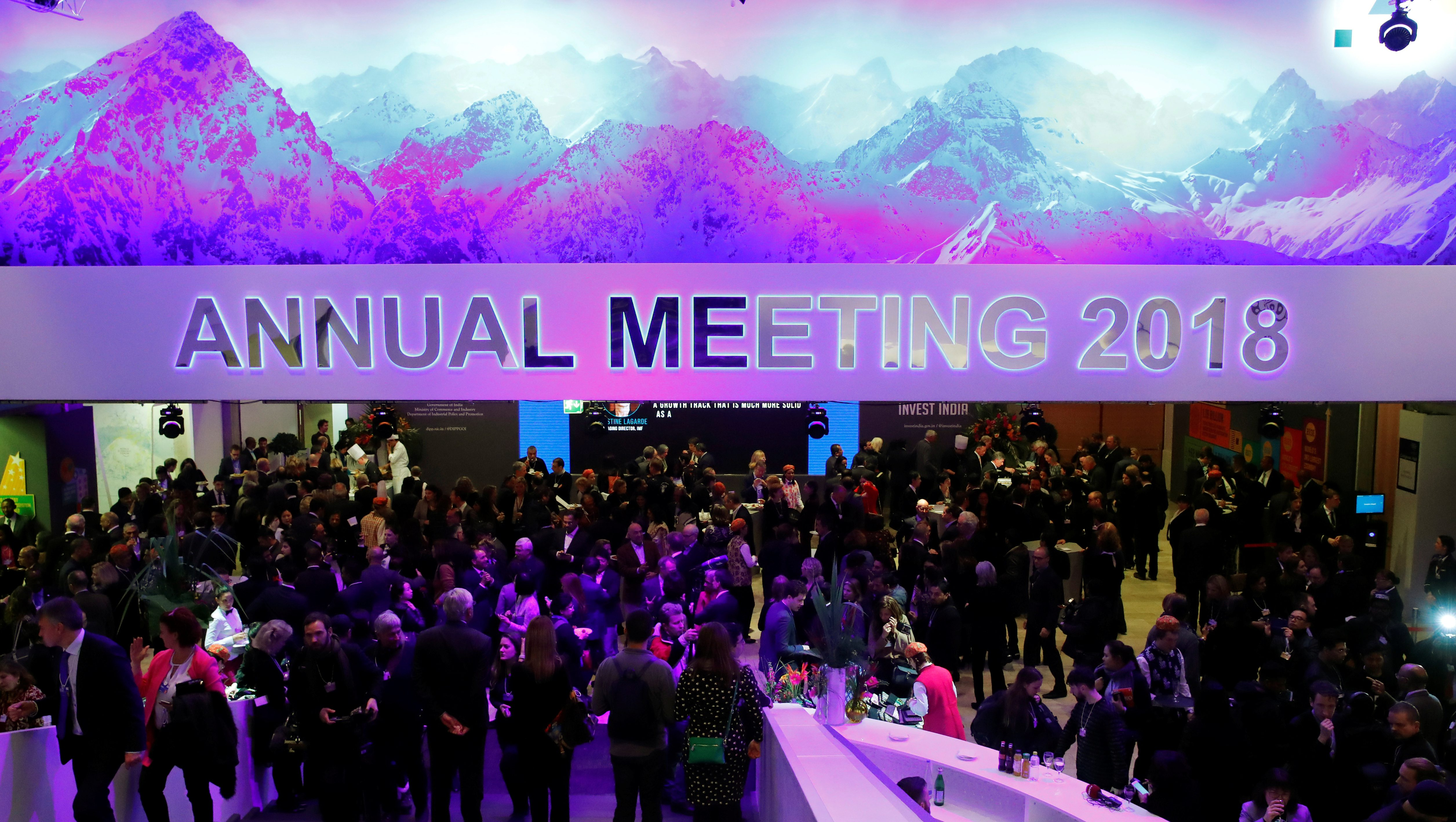 Attendees take part at a reception event after the Crystal Award ceremony during the World Economic Forum (WEF) annual meeting in Davos