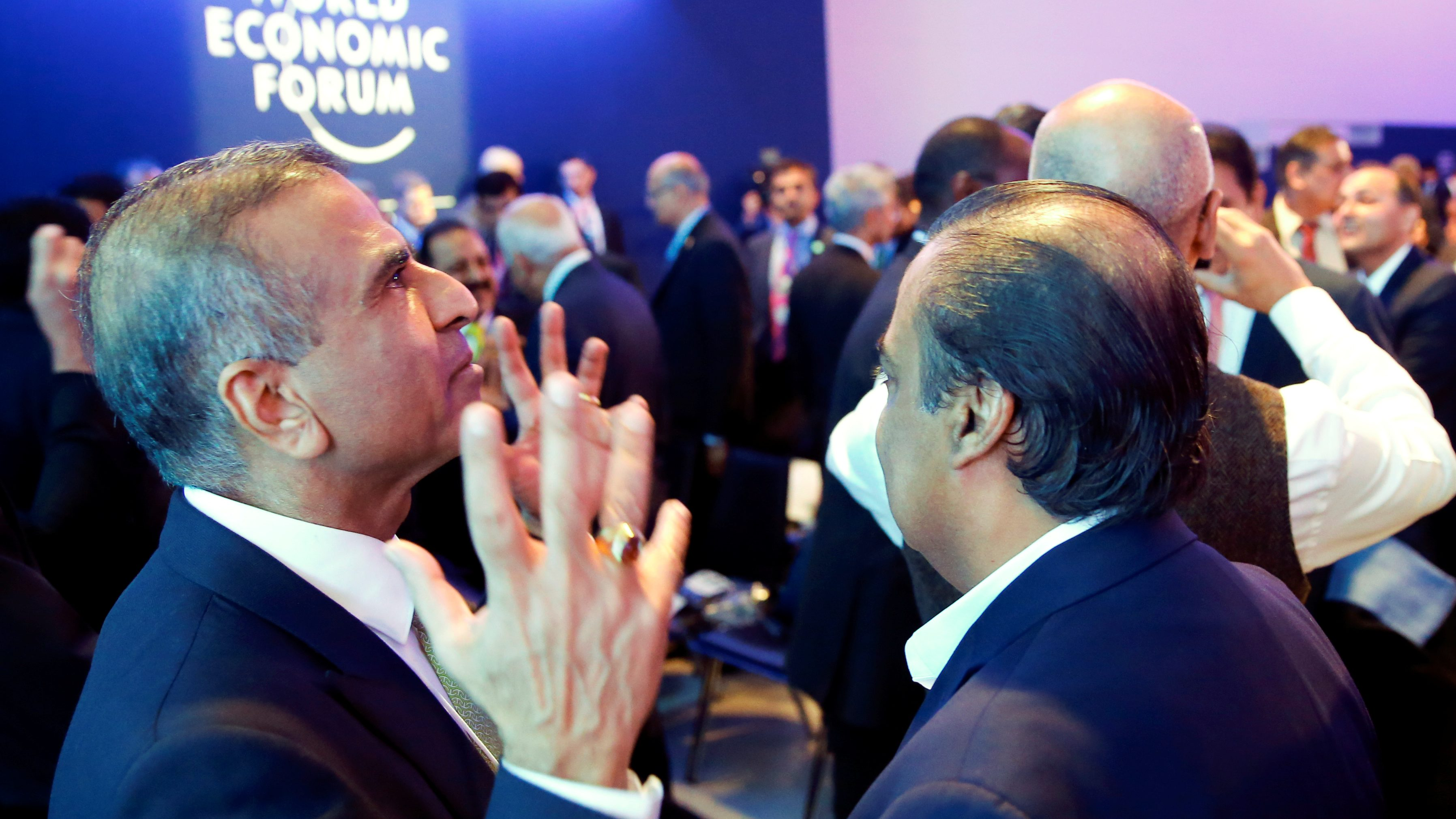 Sunil Bharti Mittal, Chairman of Bharti Enterprises (L) gestures as he speaks with Mukesh Ambani, Chairman and Managing Director of Reliance Industries, during the World Economic Forum (WEF) annual meeting in Davos, Switzerland, January 23, 2018. REUTERS/Denis Balibouse - RC1C97FBEC50