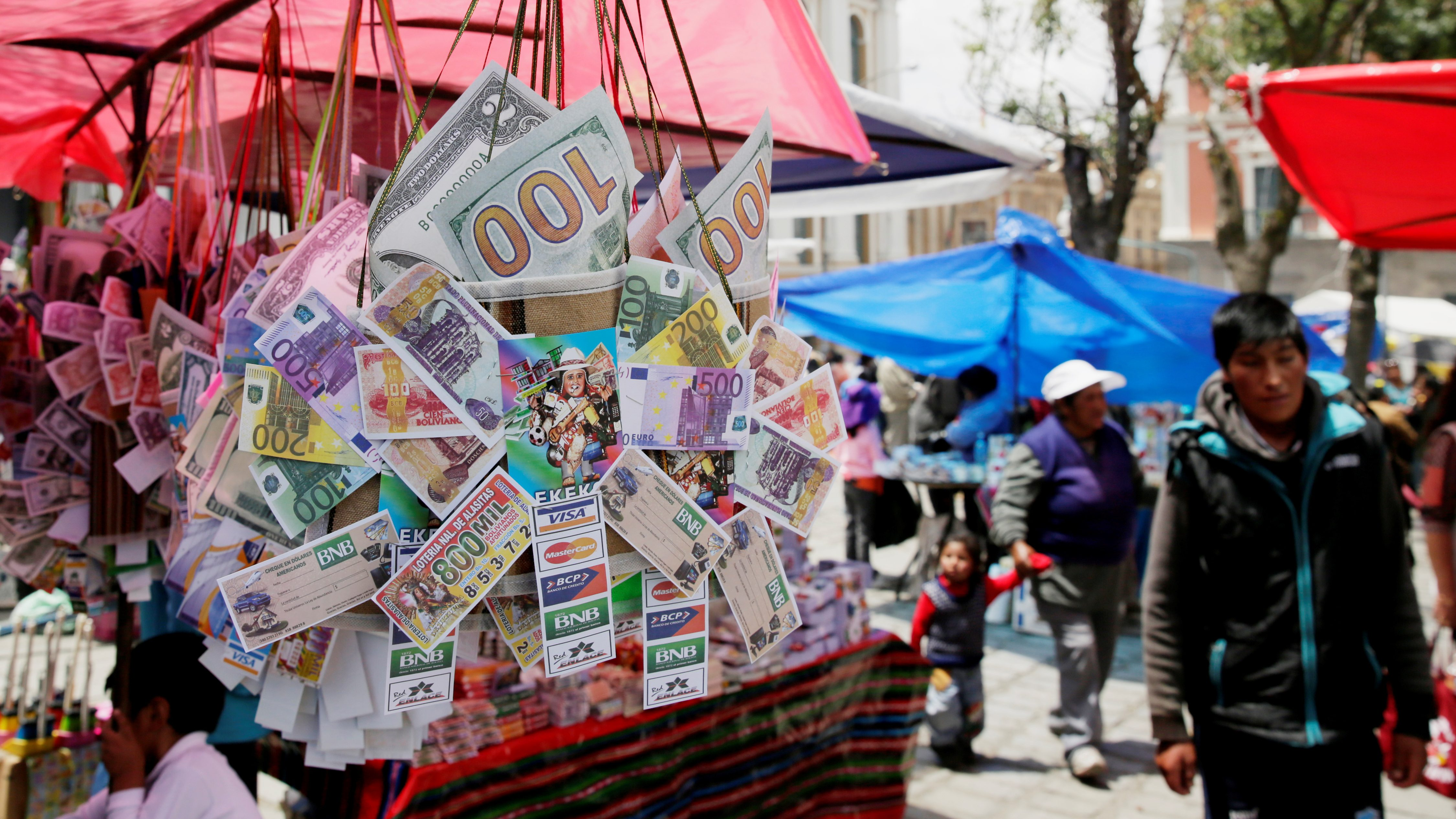 """Money, credit cards and lottery replicas are on display during the """"Alasita"""" (Buy me) fair in La Paz, Bolivia January 24, 2018. REUTERS/David Mercado - RC1EFE585DA0"""