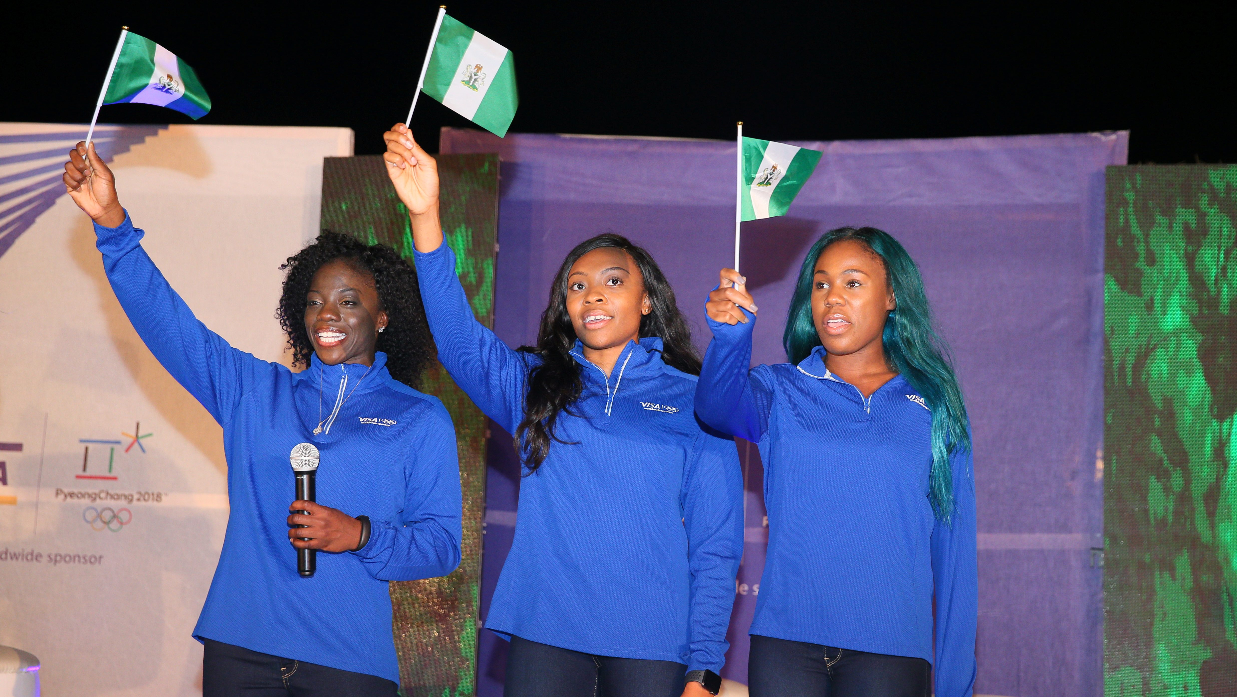 Nigerian women's bobsled team members Seun Adigun, Ngozi Onwumere and Akuoma Omeoga wave Nigeria flags during a reception organised for them in Lagos, Nigeria, as part of preparations ahead of the 2018 Pyeongchang Winter Olympic Games, February 2, 2018.