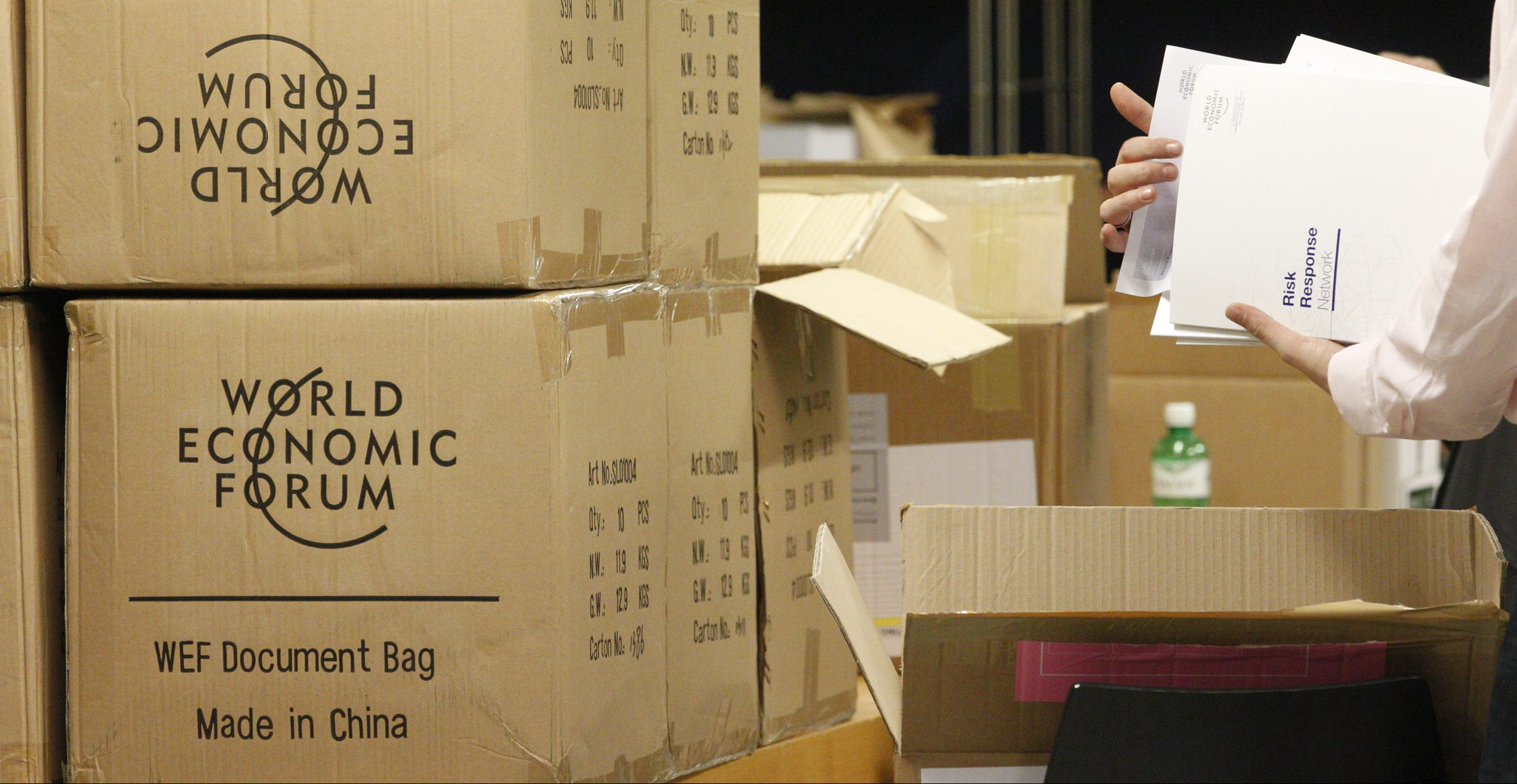 Workers pack documents on the last day of the World Economic Forum (WEF) in Davos, January 30, 2011.