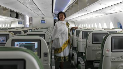 A cabin crew member dressed in a traditional outfit walks inside an Ethiopian Airlines' 787 Dreamliner after it arrived at the Jomo Kenyatta international airport in Kenya's capital Nairobi, April 27, 2013. Ethiopian Airlines on Saturday became the world's first carrier to resume flying Boeing Co's 787 Dreamliner passenger jets, landing the first commercial flight since the global fleet was grounded three months ago following incidents of overheating in the batteries providing auxiliary power.