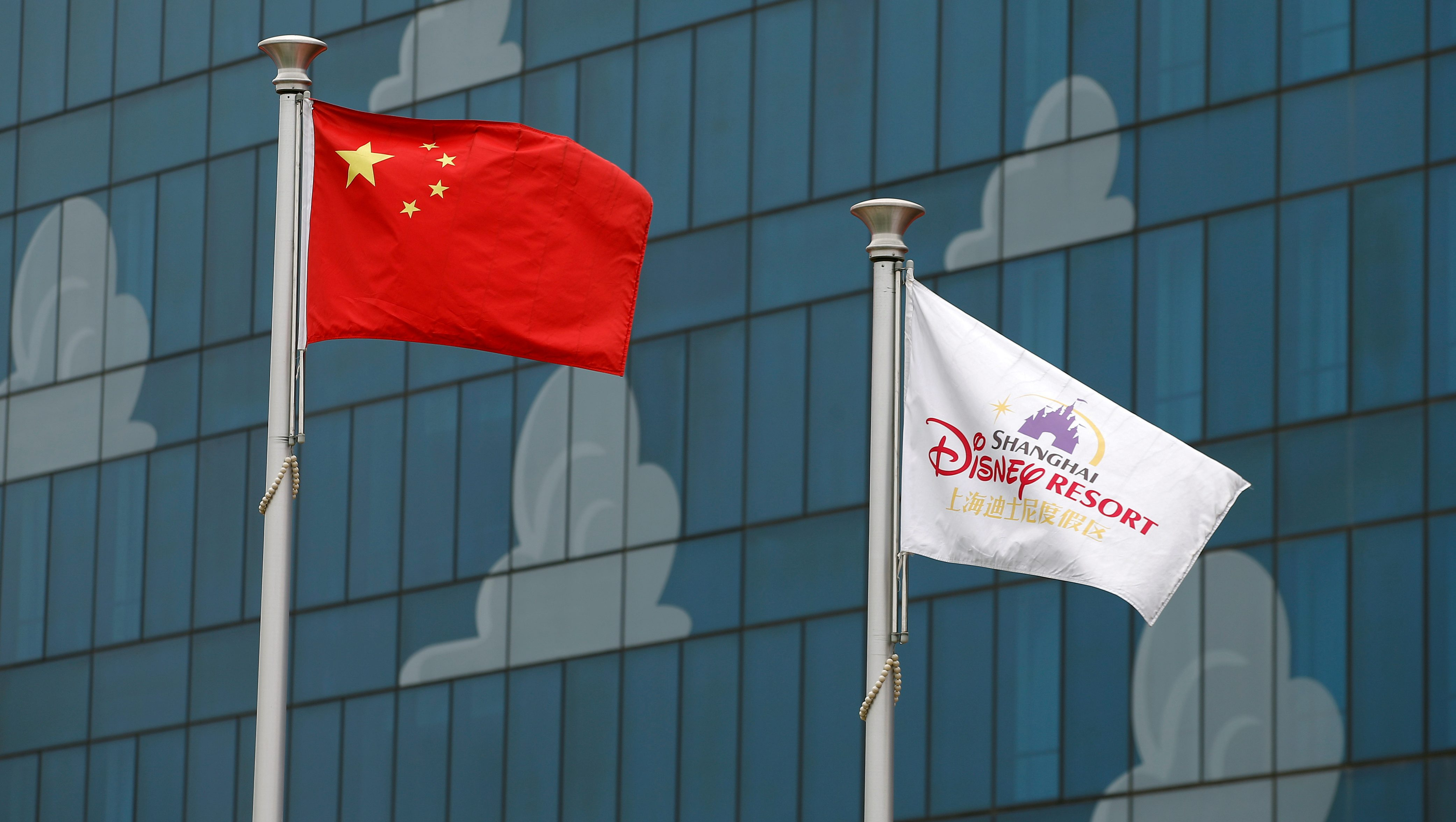 Chinese (L) and Disney flags are seen at Shanghai Disney Resort during a part of the three-day Grand Opening events in Shanghai, China, June 15, 2016.
