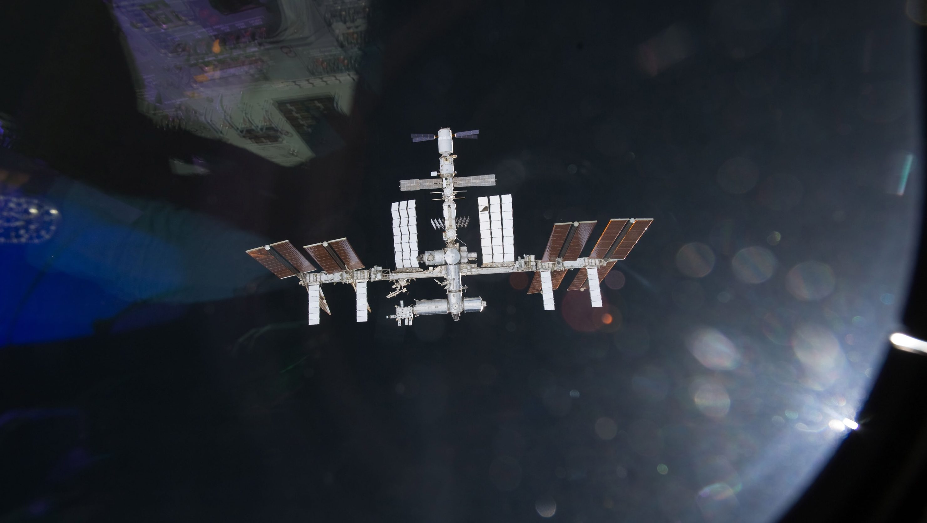 Undated handout image from NASA T.V. released on 20 May 2011 and taken by one of the crew members aboard the space shuttle Endeavour shows the International Space Station (ISS) as the two spacecraft were preparing to link up in Earth orbit. Reports state on 24 March 2012 that the crew of the ISS evacuated to escape capsules as a piece of space debris approached the space station. The debris from a Russian rocket was discovered on 23 March 2012 after it was too late to reposition the Space Station.