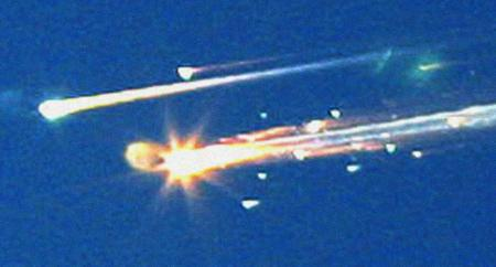 ** FILE **Debris from the space shuttle Columbia streaks across the sky over Tyler, Texas, in this Saturday, Feb. 1, 2003 file photo. Pices of the shuttle were scattered over East Texas with some debris falling in downtown Nacogdoches, Texas. Columbia disintegrated 39 miles over Texas as it returned from a 16-day mission five years ago this Friday, Feb. 1, 2008.