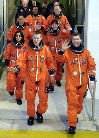 The space shuttle Columbia crew departs their quarters for the launch at the Kennedy Space Center in Cape Canaveral, Florida January 16, 2003. Clockwise from lower left are Pilot Wille McCool, Kalpana Chawla, who was raised in India, Ilan Ramon, the first Israeli to travel on the space shuttle, Michael Anderson, David Brown, Laurel Clark and Mission Commander Rick Husband in lower right. The shuttle is beginning a 16-day scientific research mission.