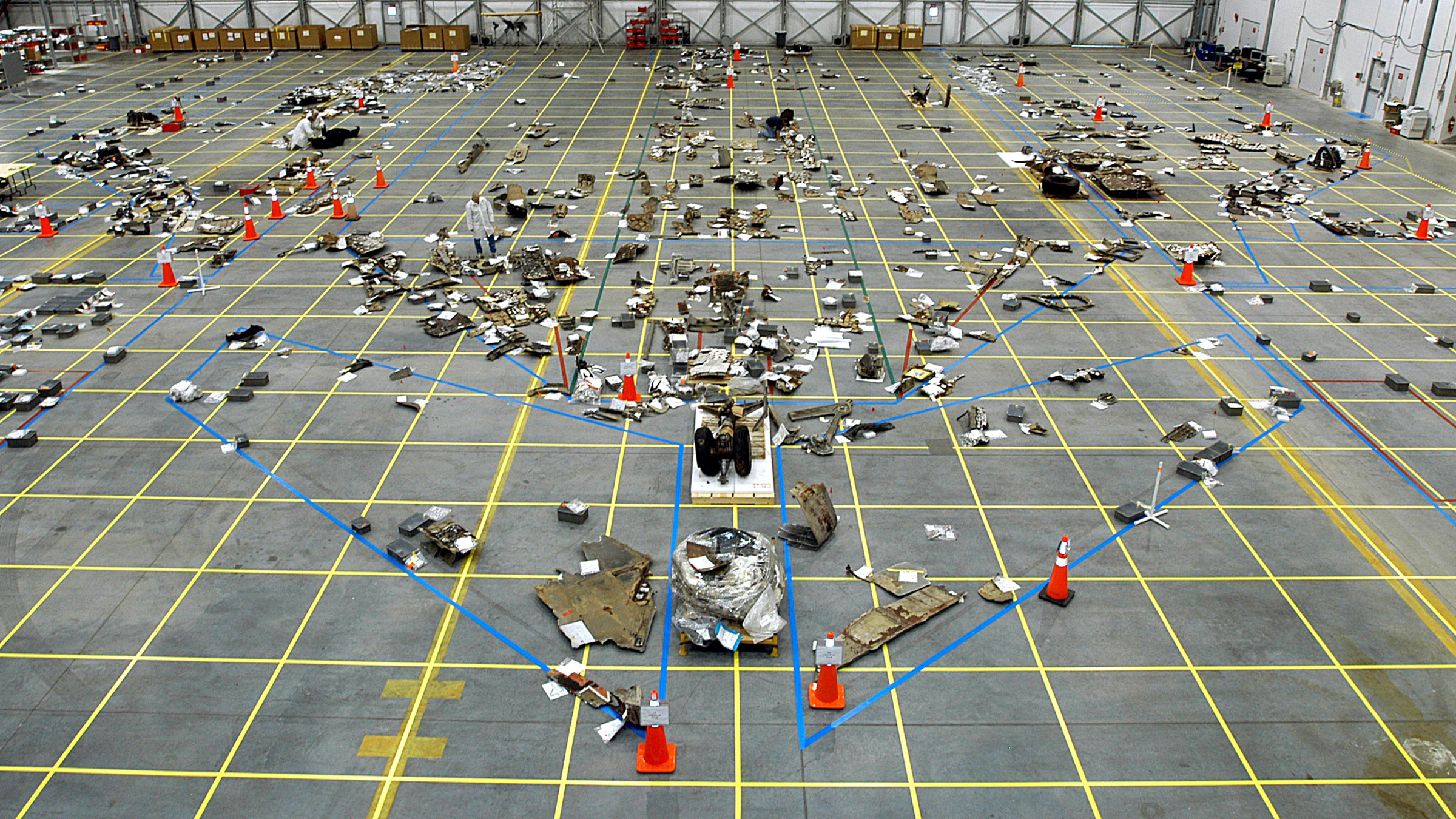 In the RLV Hangar, the floor grid is marked with a growing number of pieces of Columbia debris in this NASA handout photo dated March 13, 2003. The Columbia Reconstruction Project Team will attempt to reconstruct the orbiter as part of the investigation into the accident that caused the destruction of Columbia and loss of its crew as it returned to Earth on mission STS-107.