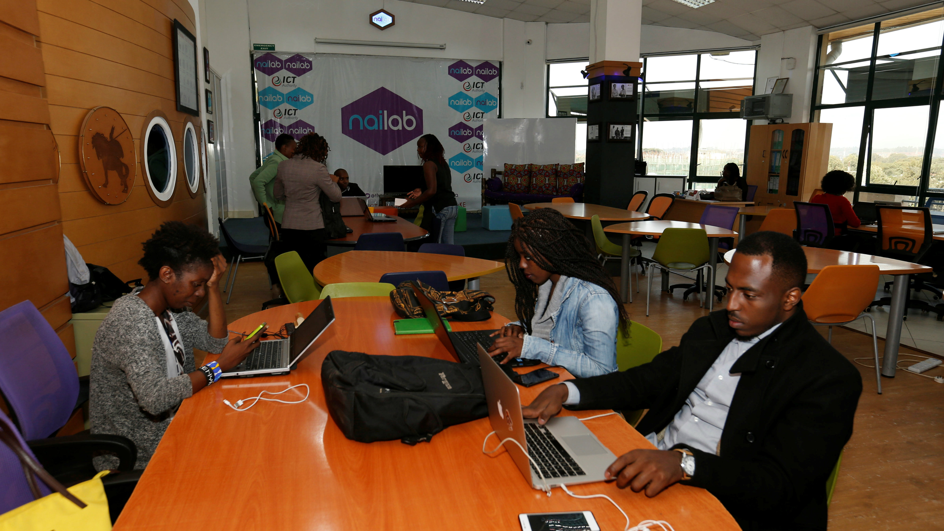 Entrepreneurs work on their projects at Nailab, a Kenyan firm that supports technology startups, behind the latest initiative, which targets entrepreneurs for their ideas on providing sex education through technology and social media in Nairobi, Kenya, July 4, 2016.