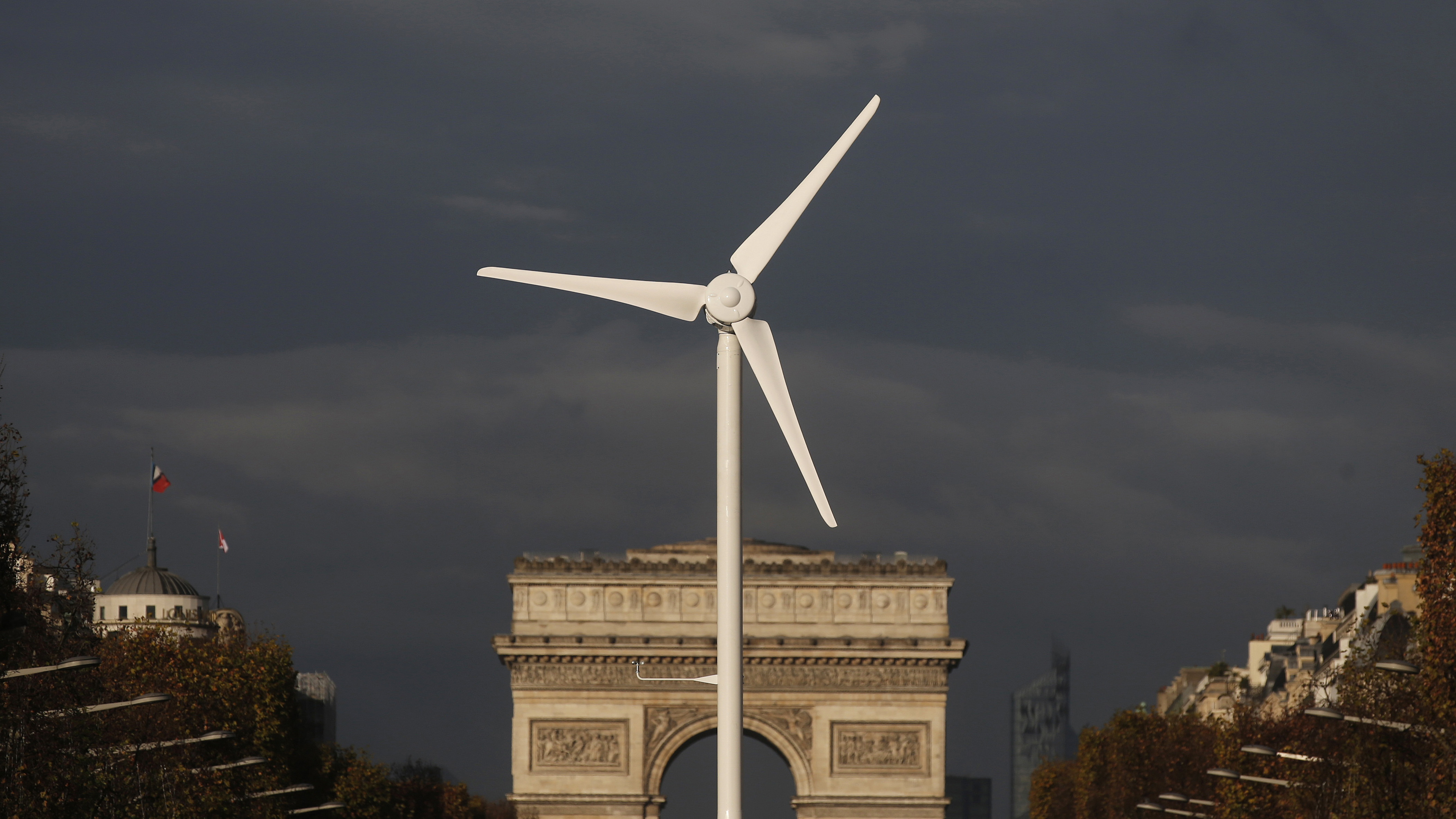 A power-generating windmill turbine is seen in front of the Arc de Triomphe on the Champs Elysees avenue ahead of the COP21 World Climate Summit in Paris