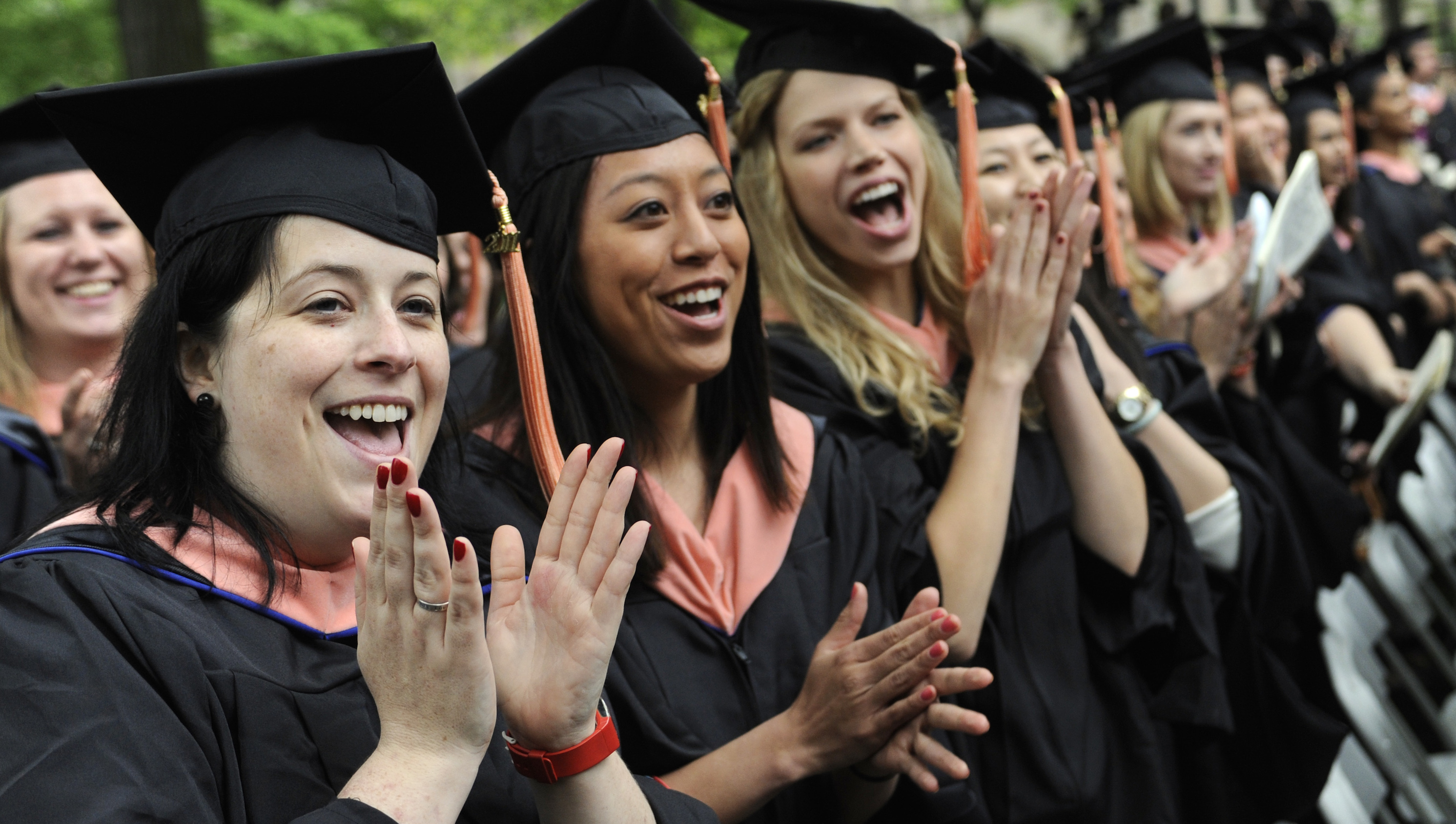 Public Health graduates Megan Leahy of Atlanta, left, Eling Tsai of Ormond Beach, Fla., and Dana Barnes of Omaha, Neb., right, celebrate during commencement exercises at Yale University in New Haven, Conn., Monday, May 23, 2011.
