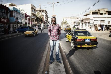 Demba Gueye in Dakar city center. Senegalese, member of Africactivists, he works as digital manager