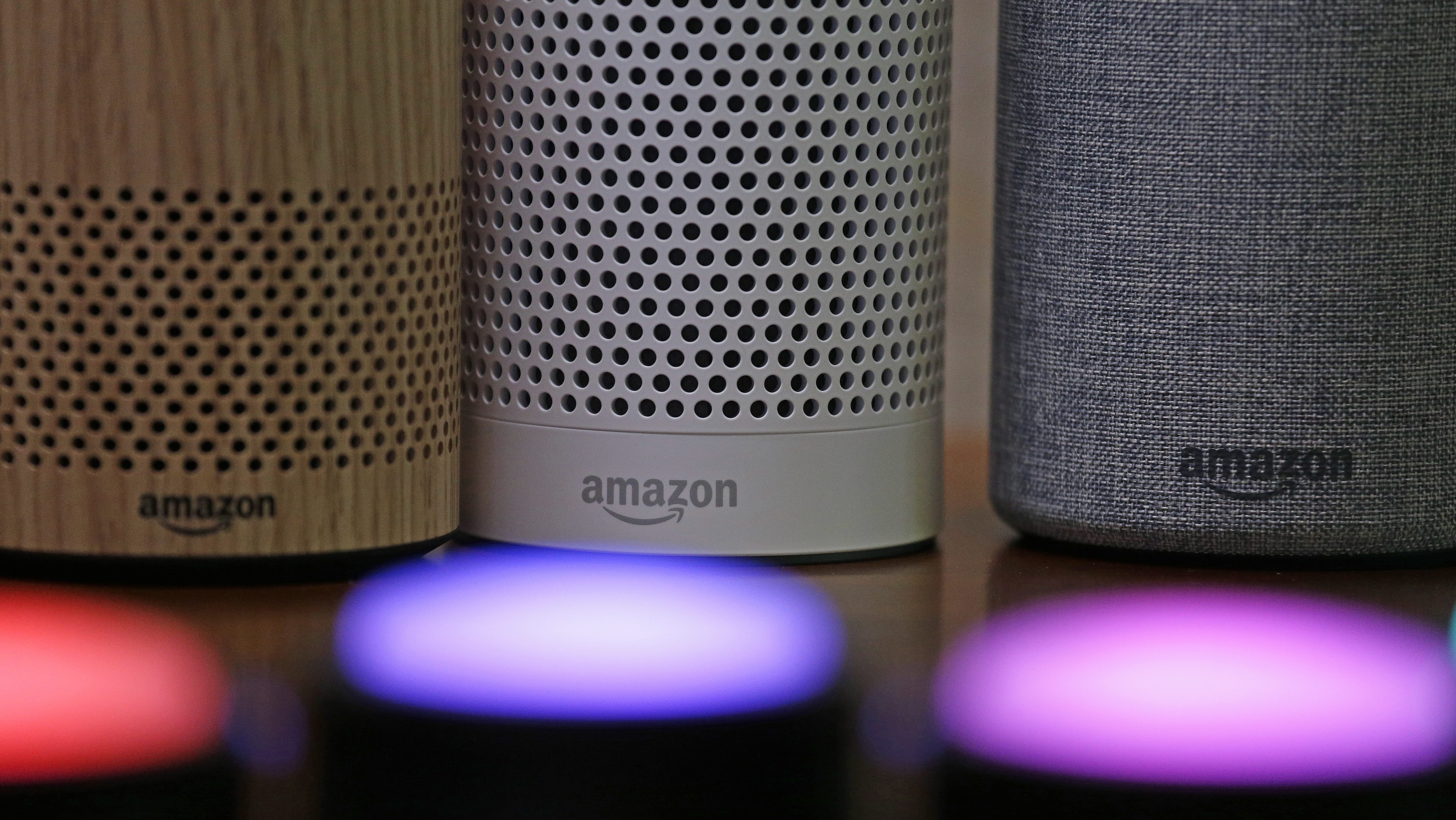 FILE - In this Wednesday, Sept. 27, 2017, file photo, Amazon Echo and Echo Plus devices, behind, sit near illuminated Echo Button devices during an event announcing several new Amazon products by the company, in Seattle. As people get voice-activated speakers and online security cameras for convenience and peace of mind, are they also giving hackers a key to their homes? Many devices from reputable manufacturers have safeguards built in, but safeguards aren't the same as guarantees.
