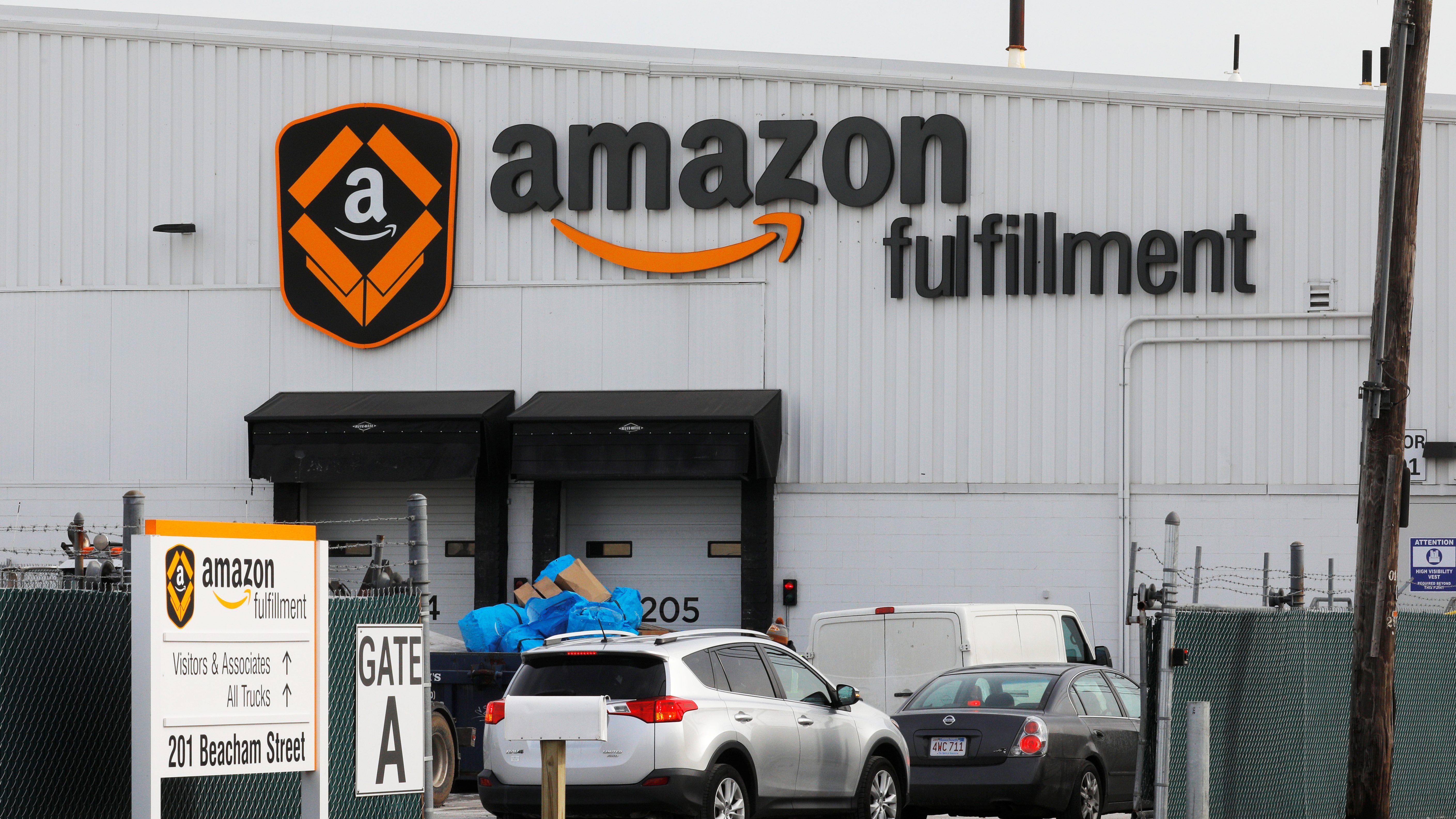 Signs mark the Amazon Fulfillment facility in Everett, Massachusetts, U.S., February 1, 2018.   REUTERS/Brian Snyder - RC1627BD1E90