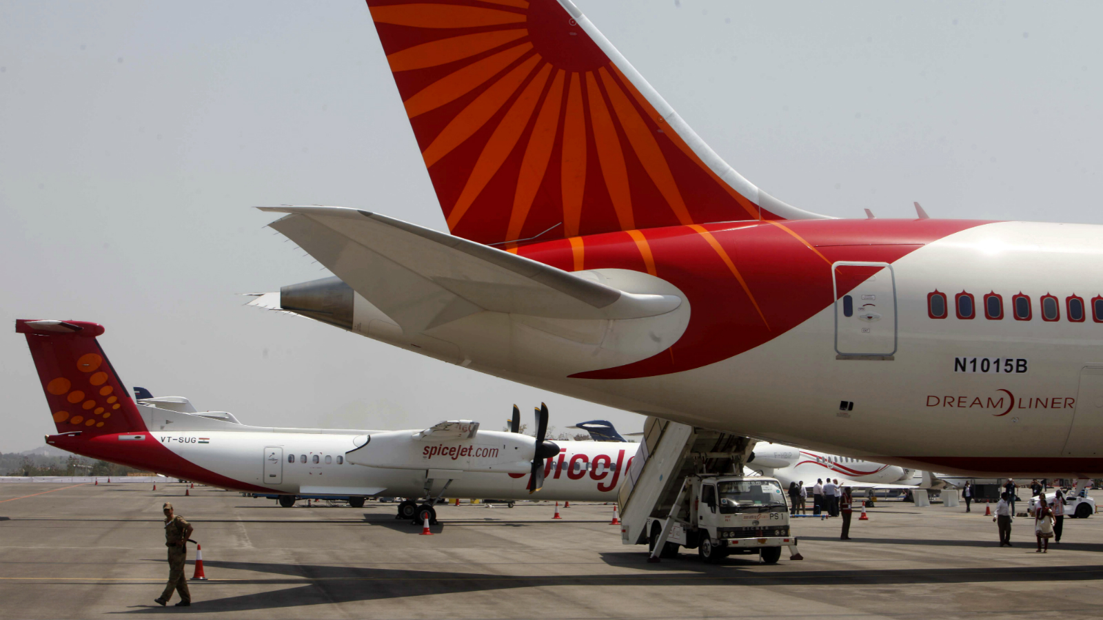 An Indian security officer stands in front of a newly inducted Air India Boeing 787-8 series Dreamliner aircraft on static display during the opening day of India Aviation 2012 in Hyderabad, India, Wednesday, March 14, 2012. The third international exhibition and conference on civil Aviation, a five day event, is scheduled to run from March 14-18, where some 250 companies will showcase the latest global aerospace technology at the event.