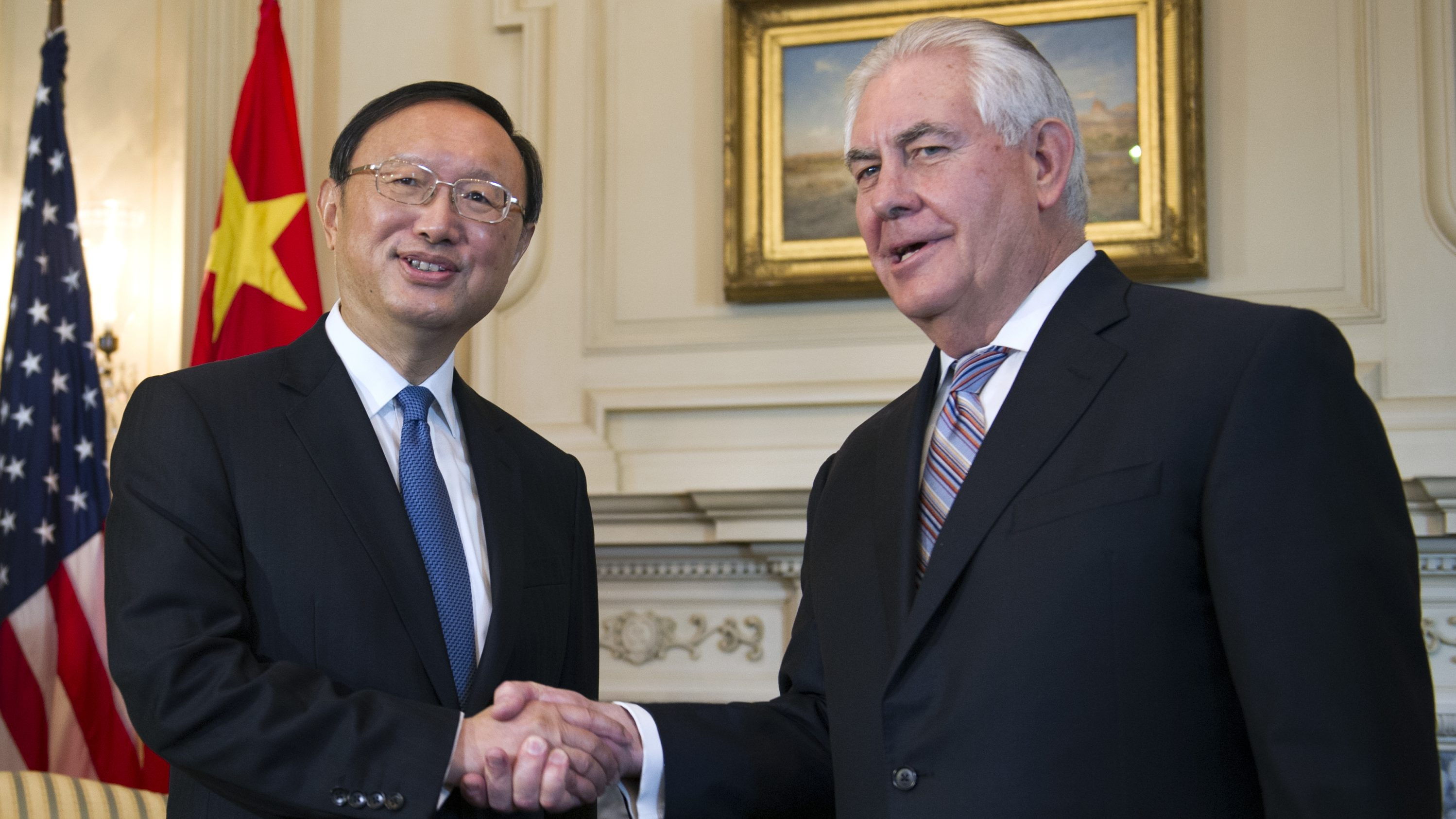 Secretary of State Rex Tillerson shakes hands with Chinese State Councilor Yang Jiechi at the State Department in Washington, Tuesday, Feb. 28, 2017.