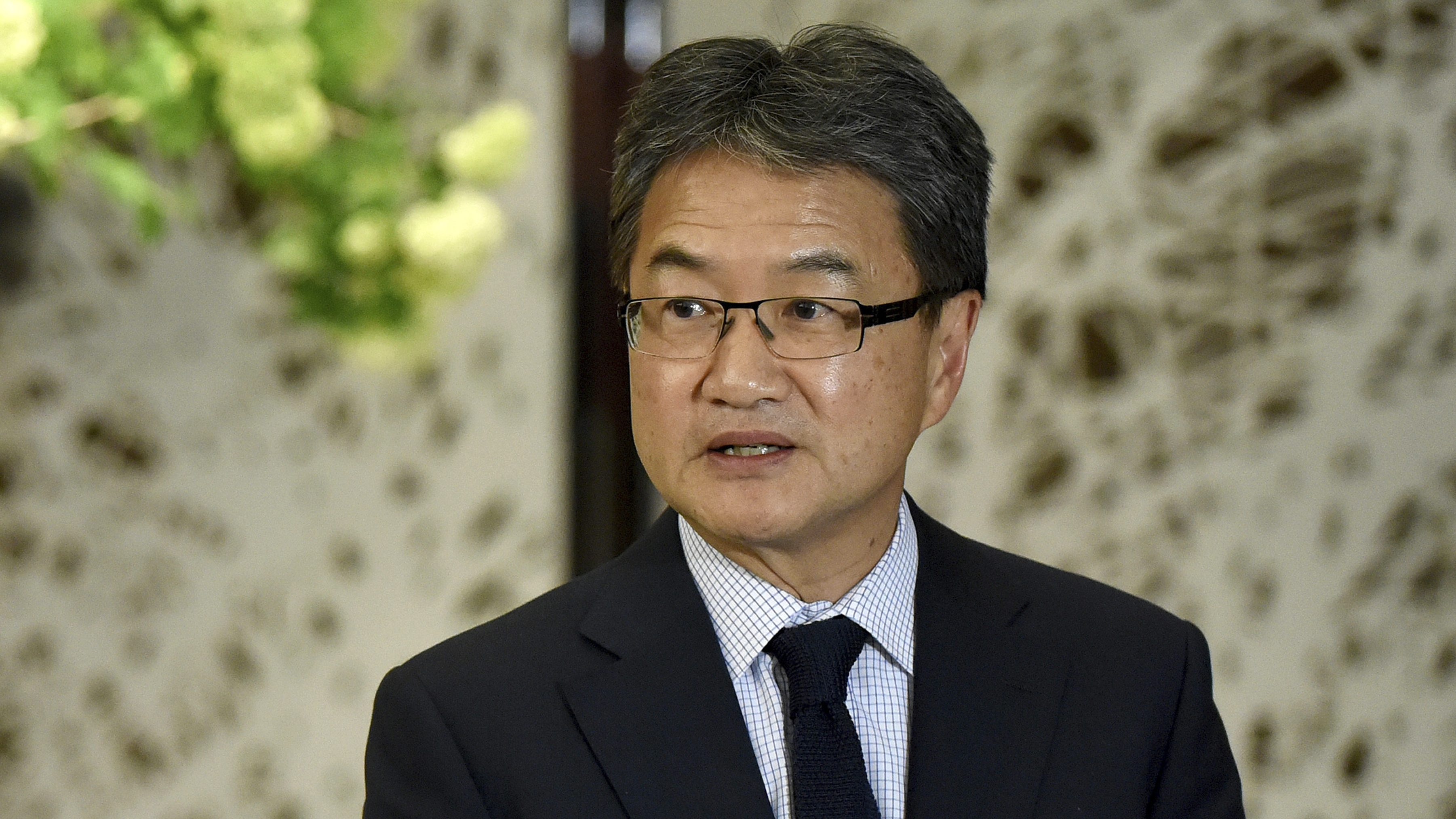 "In this April 25, 2017, file photo, U.S. special envoy for North Korea policy Joseph Yun speaks in Tokyo. It took months of ""quiet diplomacy,"" a change in U.S. presidents and an American diplomat's extraordinary, secret visit to Pyongyang to bring Otto Warmbier home. Yun was a household name to almost no one before Warmbier's return to Ohio on June 14, yet he joins an exceedingly short list of U.S. officials to set foot in furtive North Korea in recent years. The last such visit is believed to have been in November 2014, when former National Intelligence Director James Clapper brought home two other jailed Americans."
