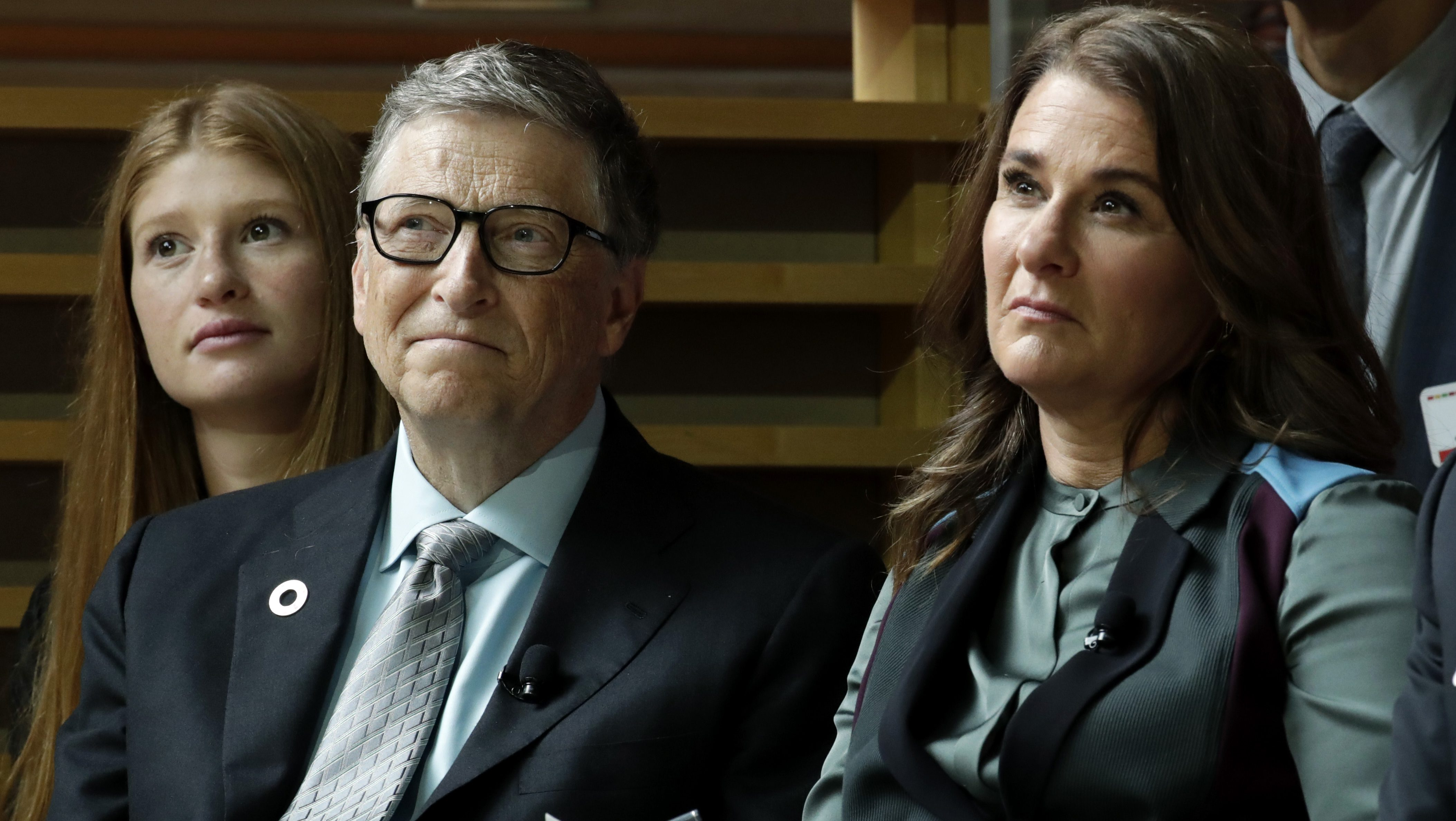 Bill Gates, left, and his wife, Melinda Gates, listen to former President Barack Obama speaks during the Goalkeepers Conference, Wednesday, Sept. 20, 2017, in New York. (AP Photo/Julio Cortez)