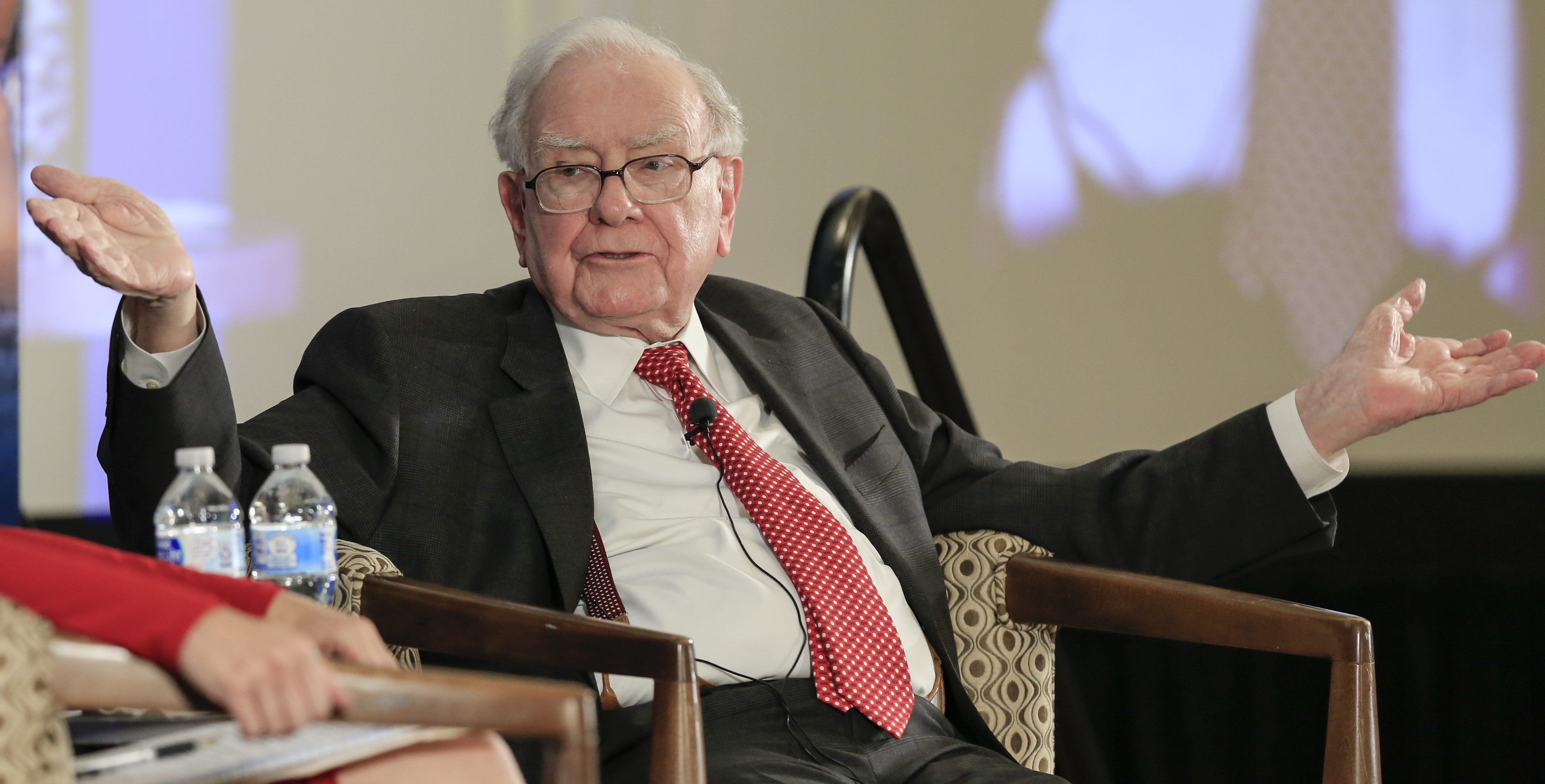 Investor Warren Buffett gestures on stage during a conversation with CNBC's Becky Quick, at a national conference sponsored by the Purpose Built Communities group that Buffett supports, in Omaha, Neb., Tuesday, Oct. 3, 2017, Buffett discussed what philanthropy can do to help fight poverty. (AP Photo/Nati Harnik)