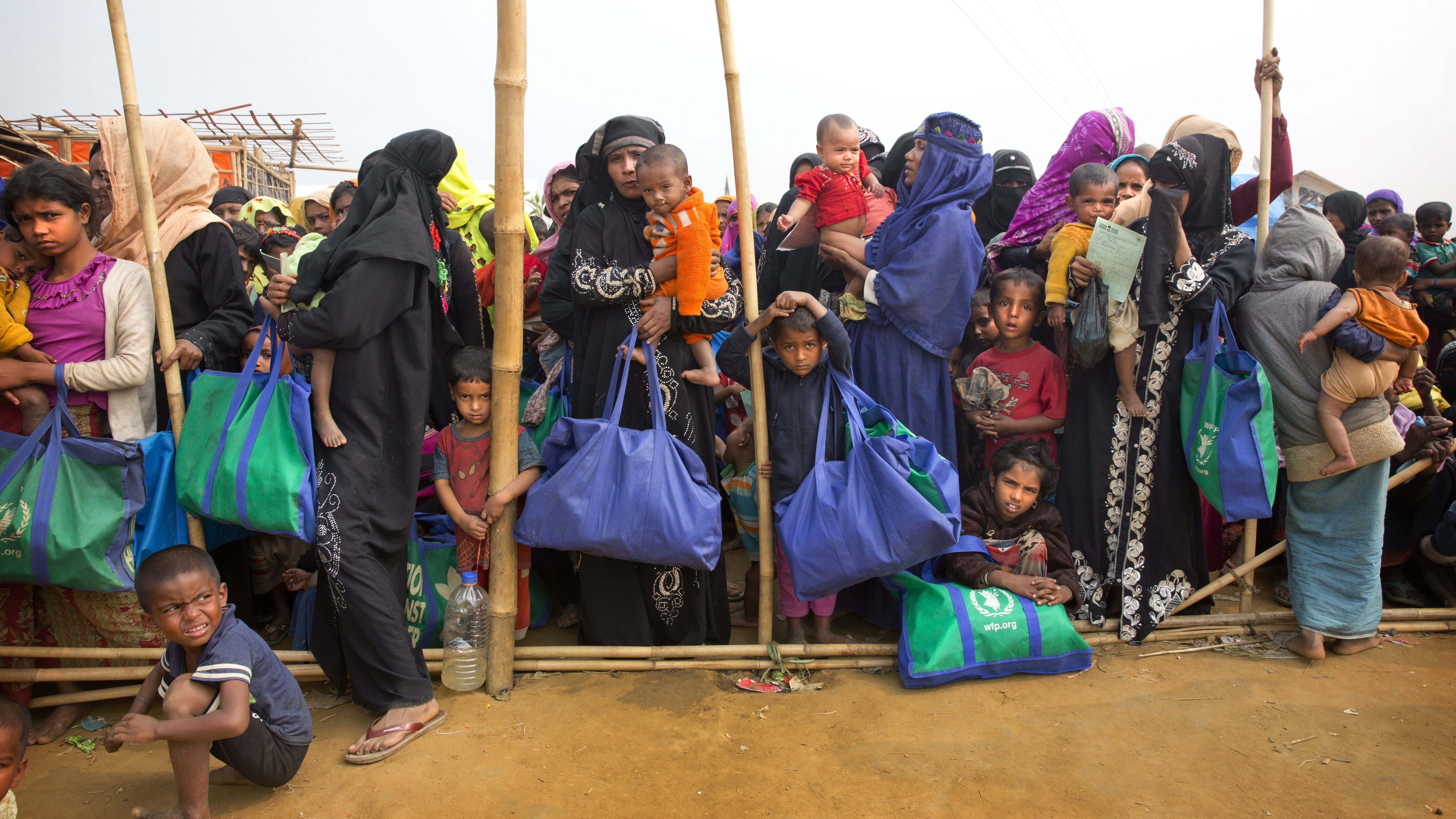 In this Jan. 15, 2018, file photo, Rohingya women stand with their children as they wait for food at the Balukhali refugee camp outside Cox's Bazar, Bangladesh. (AP Photo/Manish Swarup, File)