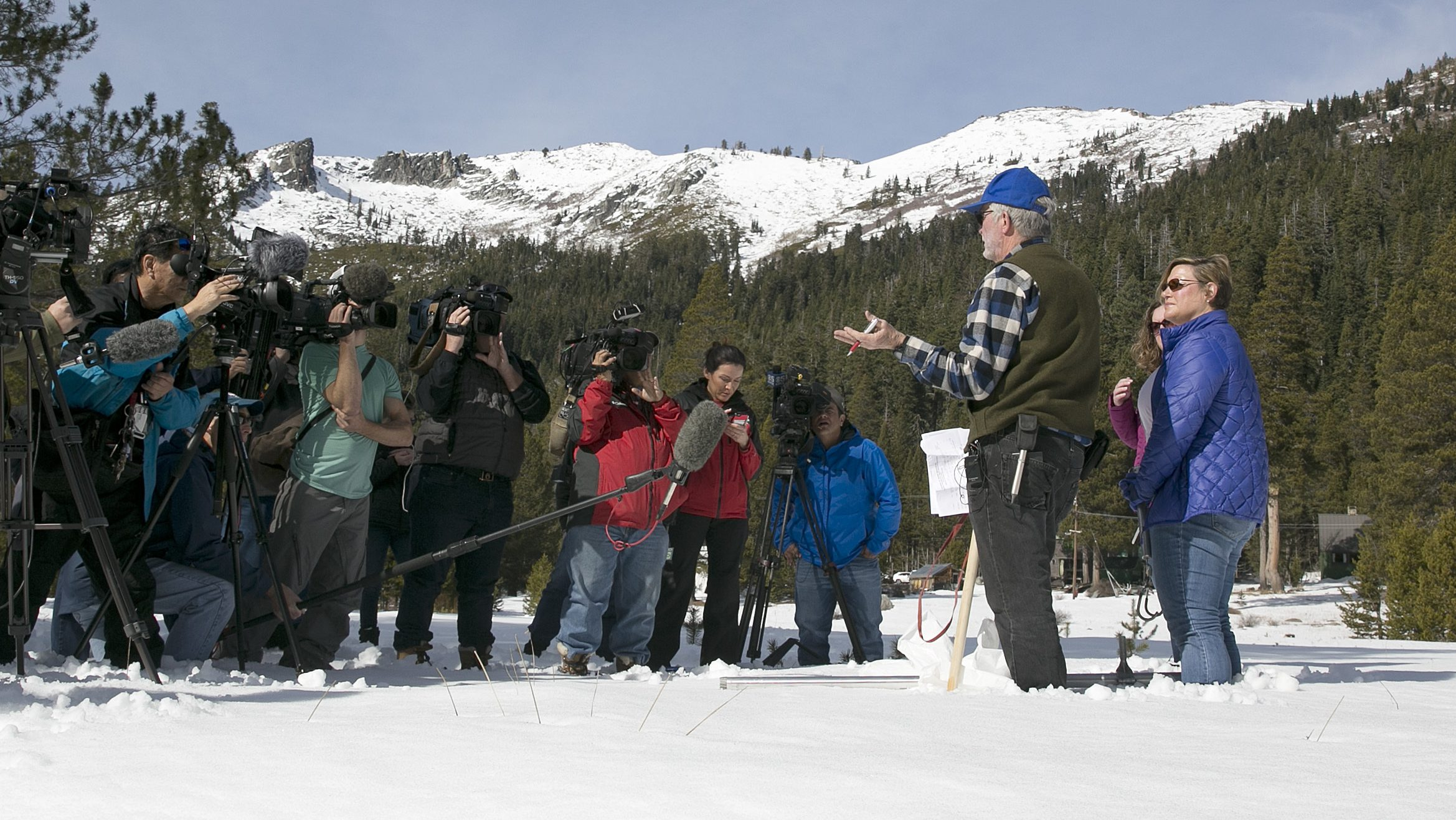 Researchers conduct a snow survey in the Sierra Nevada mountains in California.