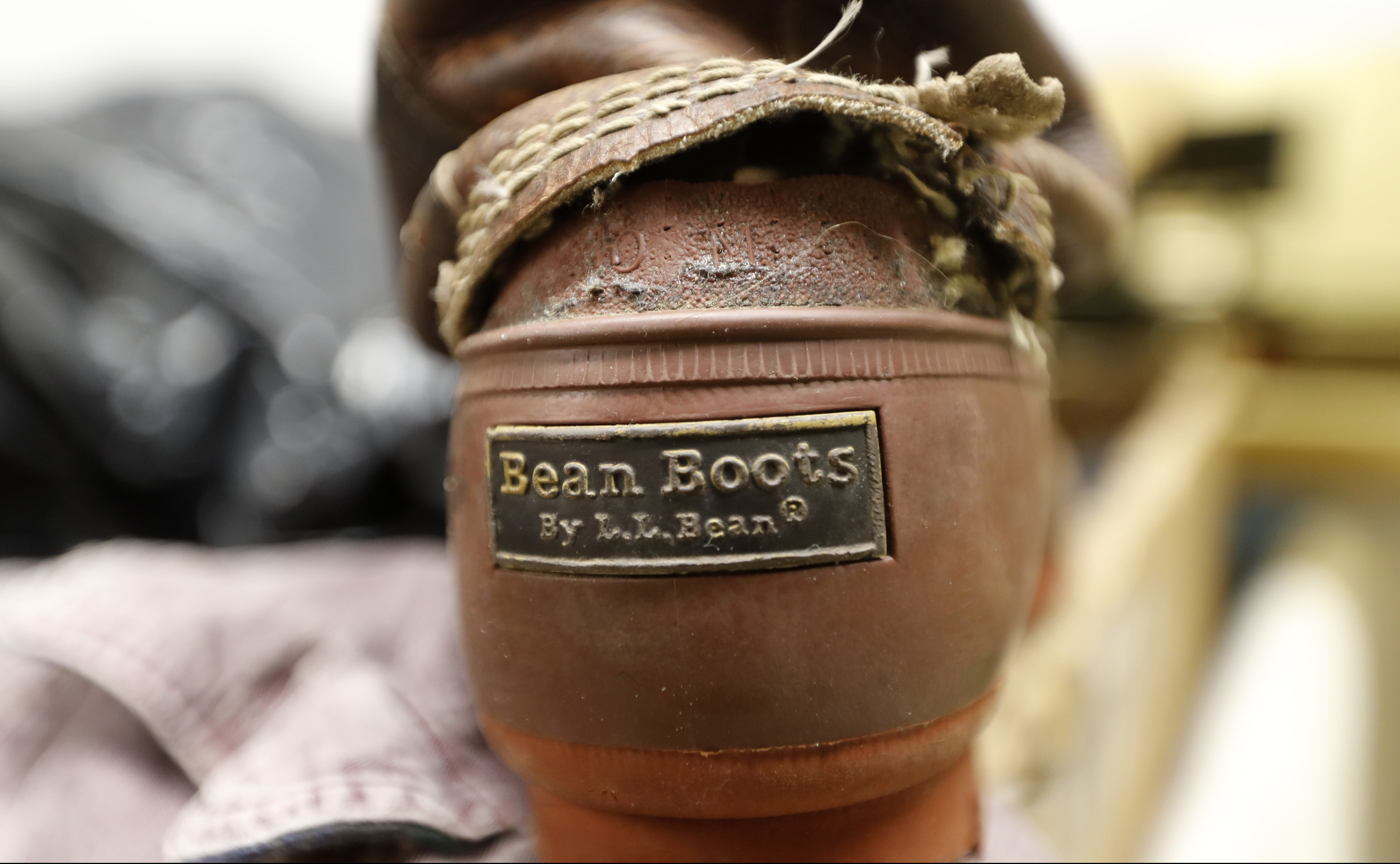 In this Friday, Feb. 2, 2018 photo a Bean Boot is seen in the return bin at L.L. Bean retail store in Freeport, Maine. Although the company is changing its return policy it will always accept returns on products that have failed, such as this boot. (AP Photo/Robert F. Bukaty)