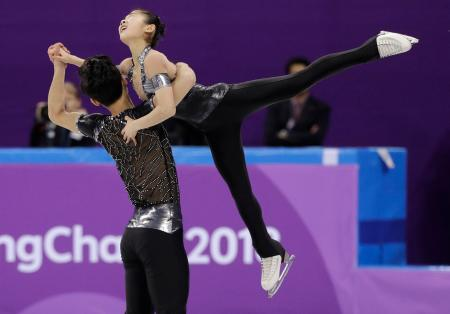 Ryom Tae Ok and Kim Ju Sik of North Korea perform in the pair figure skating short program in the Gangneung Ice Arena at the 2018 Winter Olympics in Gangneung, South Korea, Wednesday, Feb. 14, 2018. (AP Photo/David J. Phillip)