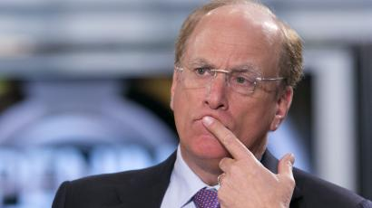 Larry Fink holds his finger on his lips