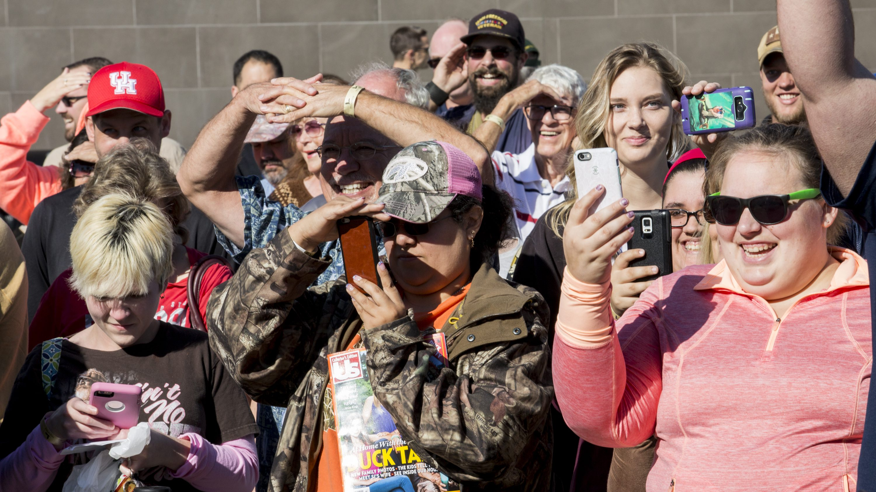 IMAGE DISTRIBUTED FOR DICK'S SPORTING GOODS - Fans take photos of Phil Robertson, reality television star from the Duck Dynasty series, during a recent store appearance at the new DICK'S Sporting Goods Grand Opening Celebration at the Baybrook Mall in Friendswood, TX on Friday, October 21, 2016.  (Photo by Scott Dalton/Invision for DICK'S Sporting Goods/AP Images)