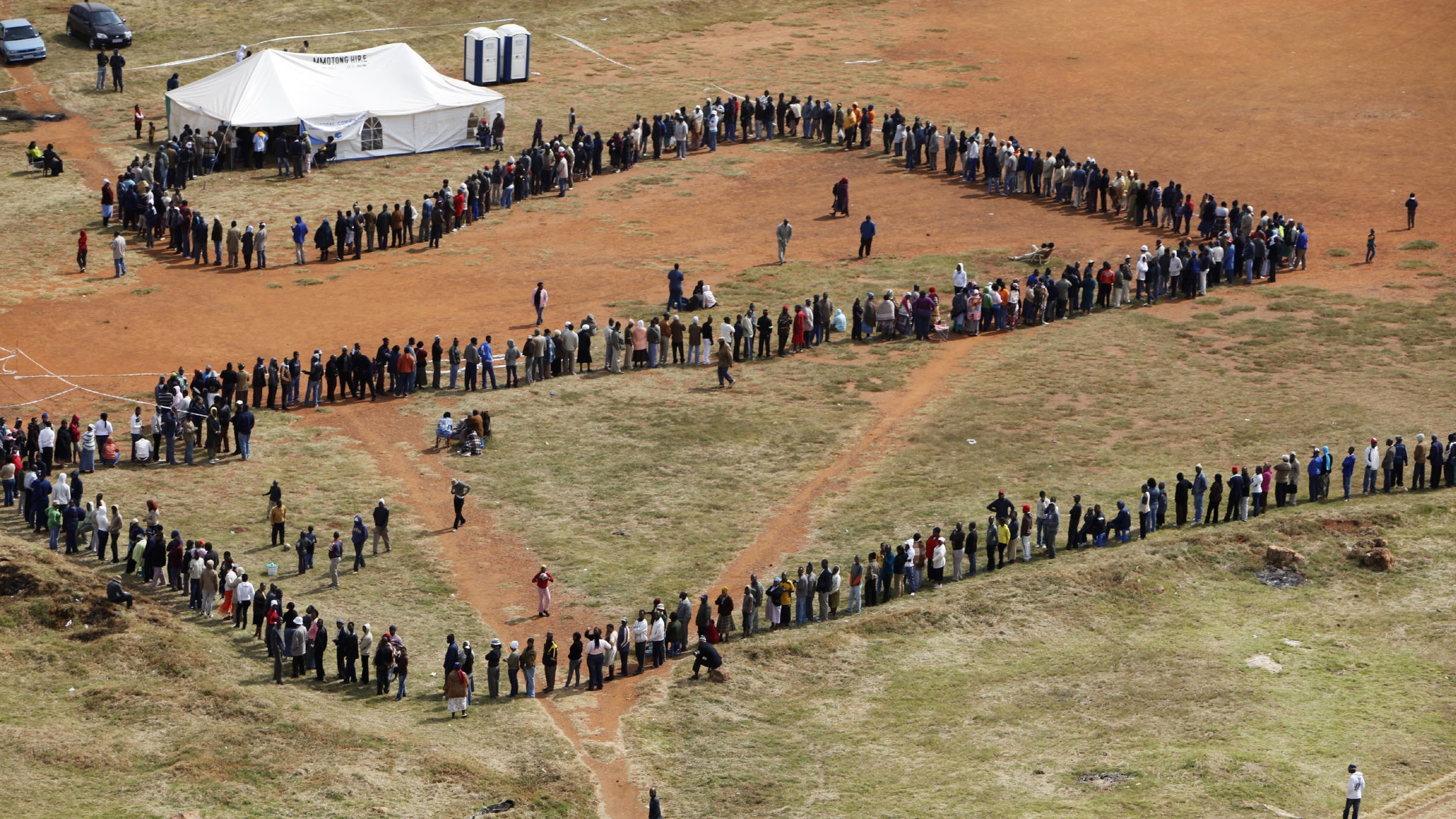 People queue to cast their votes at a polling station in the Katlehong township, east of Johannesburg, South Africa, Wednesday, April 22, 2009. Voters lined up before sunrise Wednesday in an election that has generated an excitement not seen since South Africa's first multiracial vote in 1994, and that was expected to propel Jacob Zuma to the presidency after he survived corruption and sex scandals. (AP Photo/Denis Farrell)