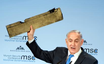 Israeli Prime Minister Benjamin Netanyahu holds up a remnant of what he said was a piece of Iranian drone which was shot down in Israeli airspace during his speech at the Munich Security Conference, Germany February 18, 2018.
