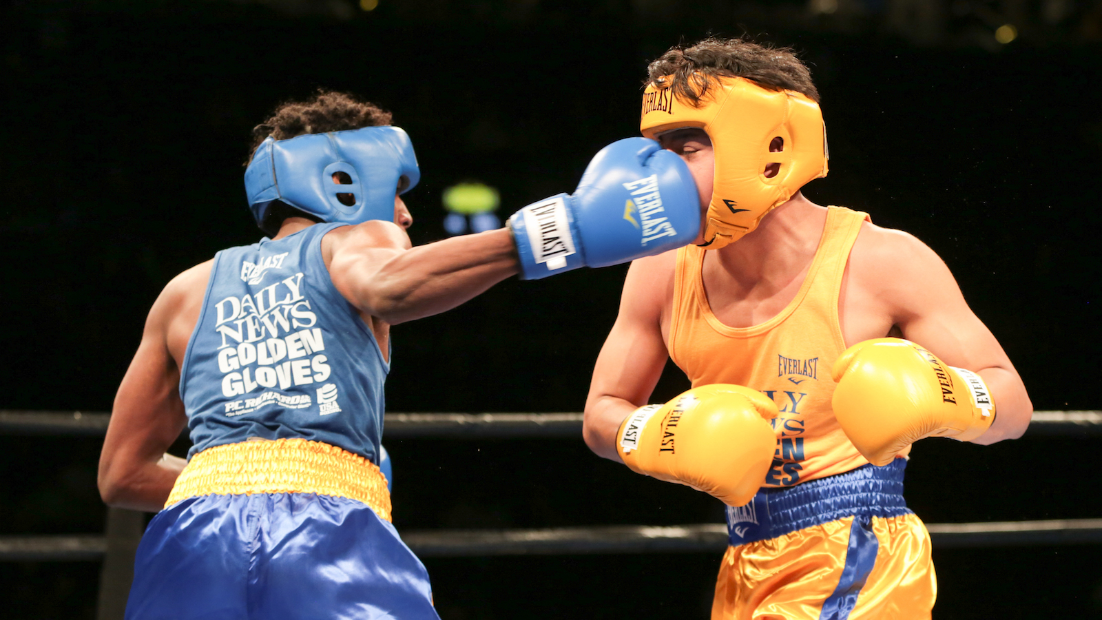 Brandon Browne, left, fights against Christopher Cuellar at the 89th Annual Golden Gloves boxing tournament finals, on Monday, April 18, 2016, in New York. Brandon Browne won via technical knockout in the first round. (AP Photo/Steve Luciano)
