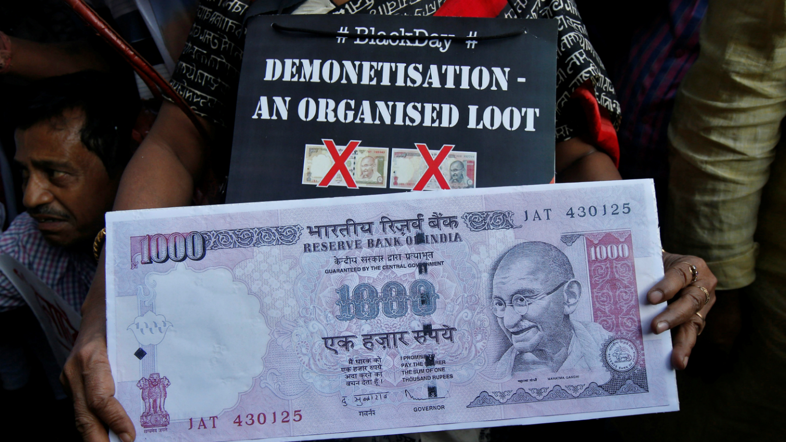 A demonstrator holds a replica of an abolished 1000 ruppee note during a protest, organised by India's main opposition Congress party, to mark a year since demonetisation was implemented by Prime Minister Narendra Modi, in Kolkata, India, November 8, 2017