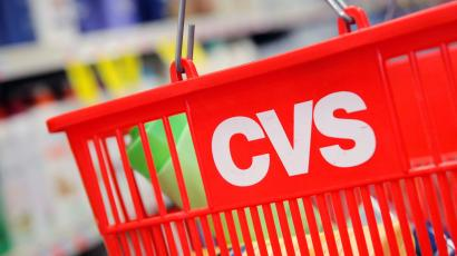 A shopping basket with the CVS logo.